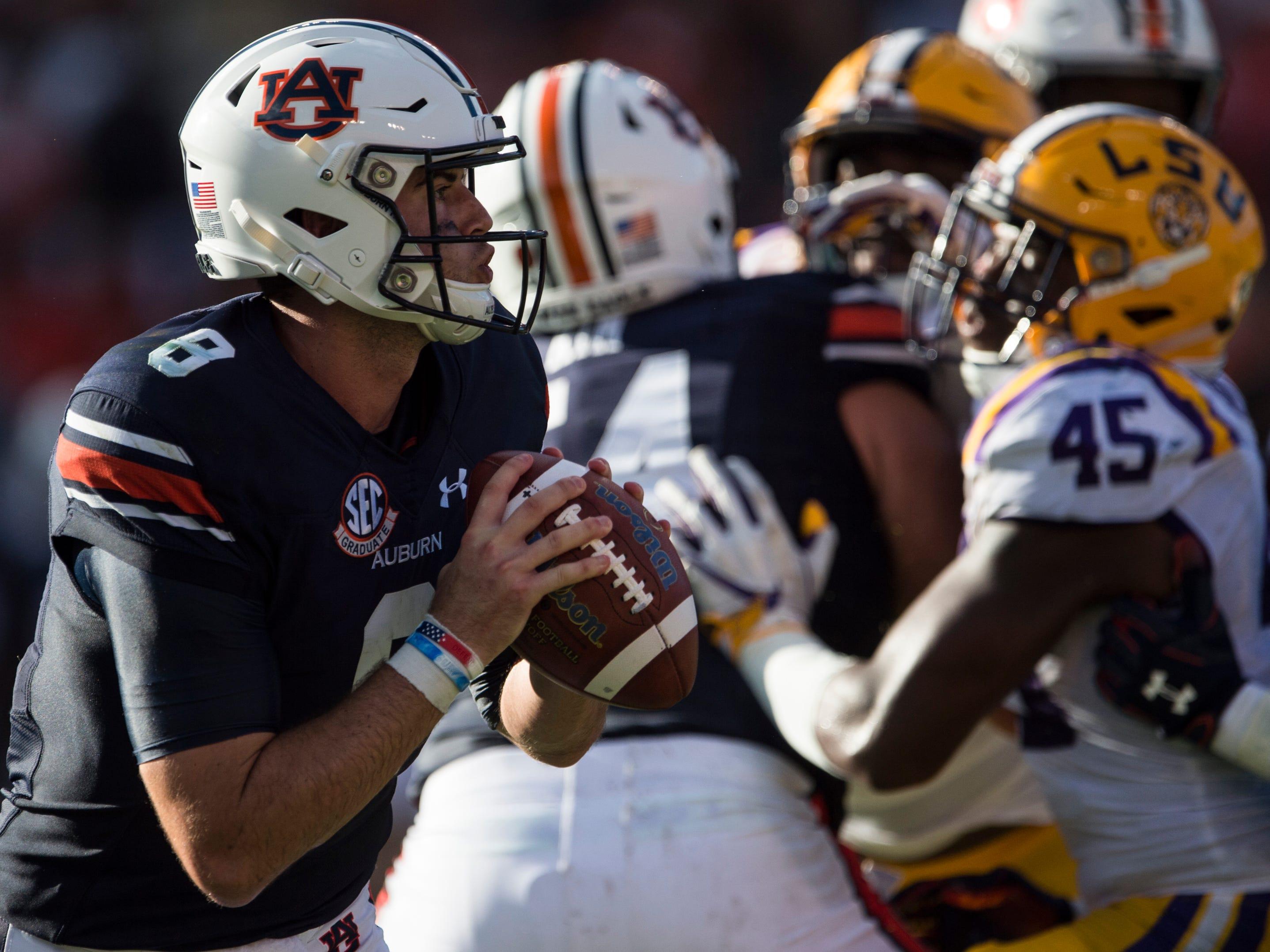 Auburn's Jarrett Stidham (8) looks to make a pass against LSU at Jordan-Hare Stadium in Auburn, Ala., on Saturday, Sept. 15, 2018. LSU defeated Auburn 22-21.