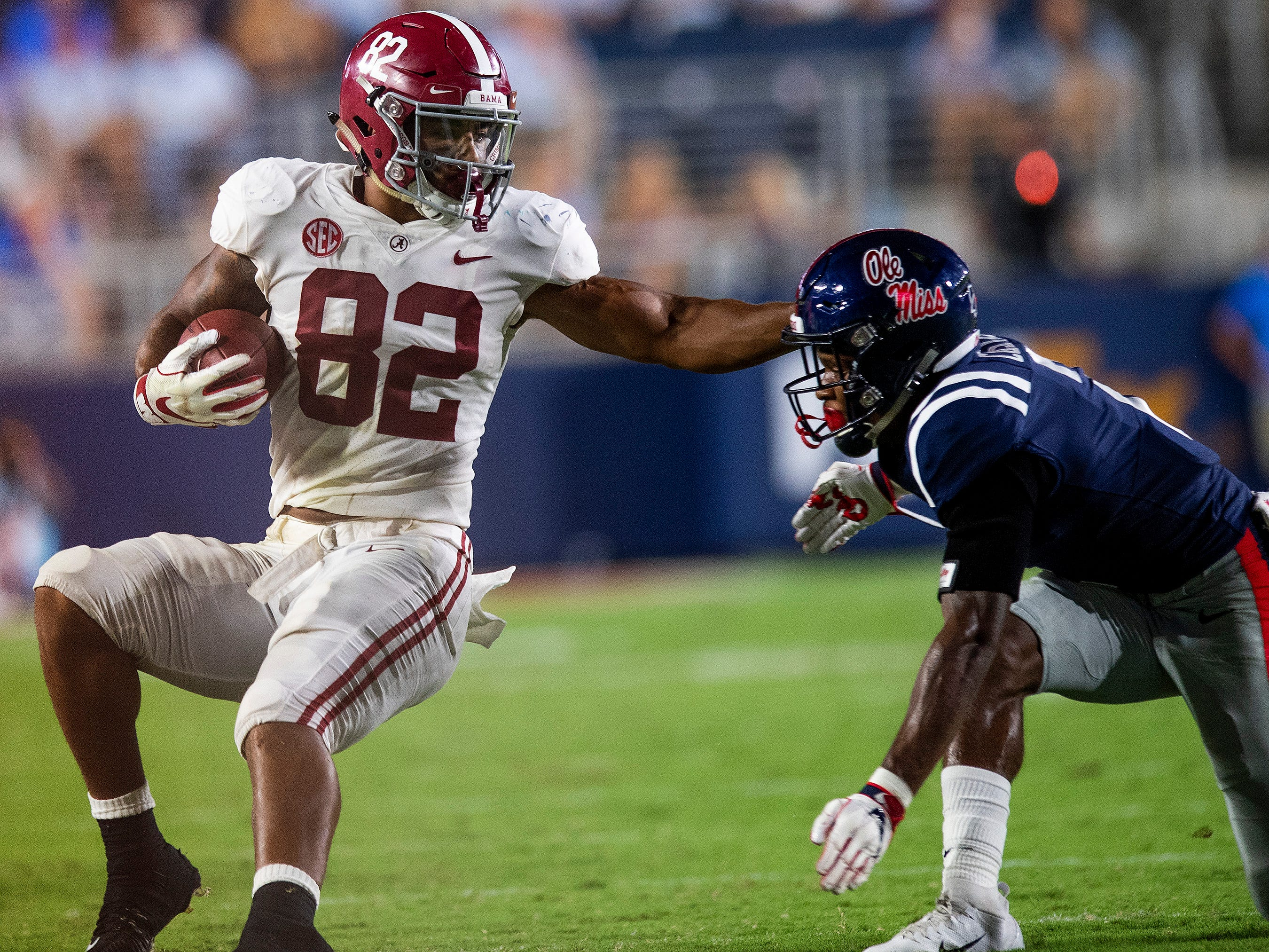 Alabama tight end Irv Smith Jr. (82) is stopped by Ole Miss defensive back Montrell Custis (2) In first half action in Oxford, Ms., on Saturday September 15, 2018.