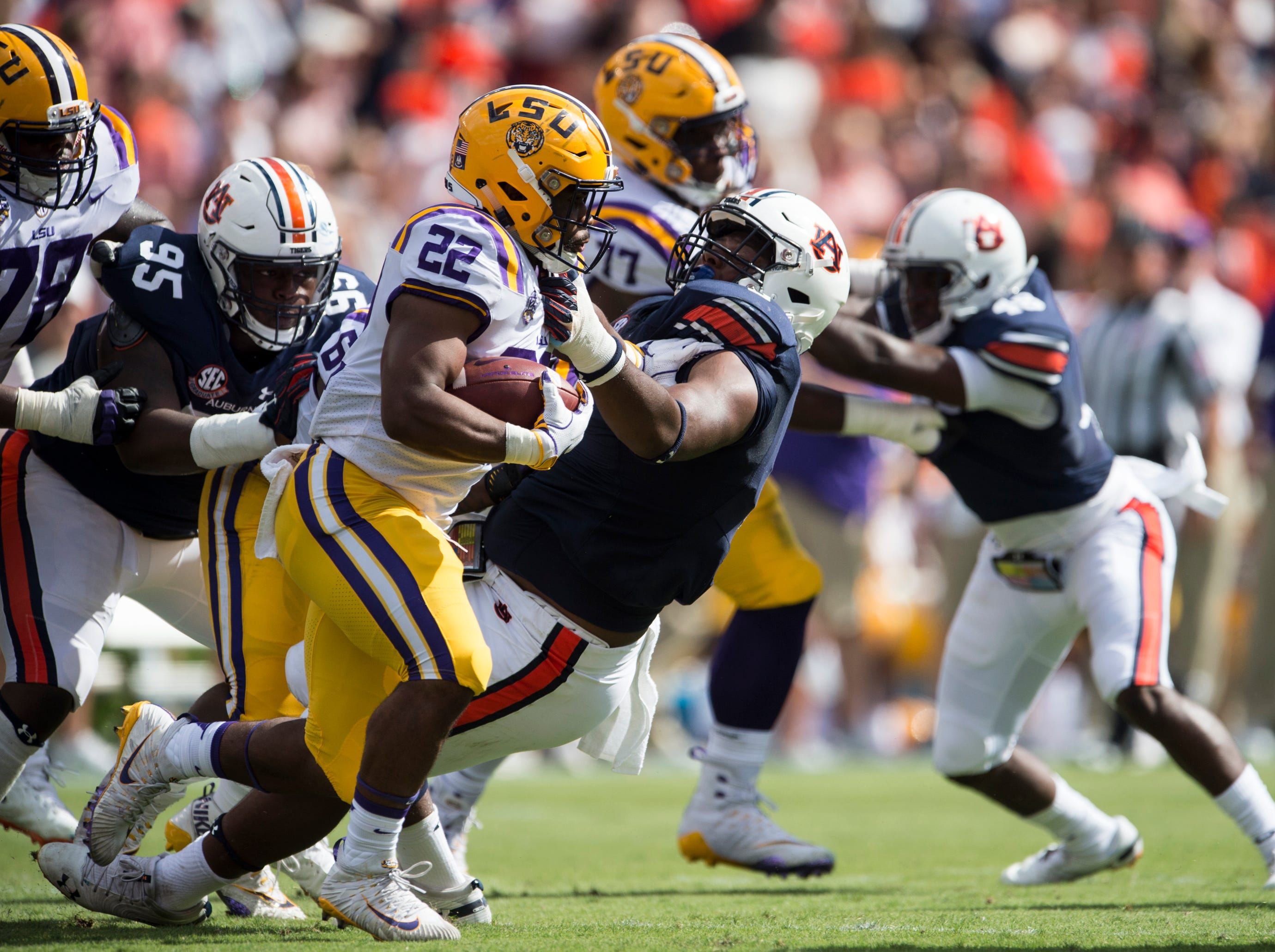 Auburn's Derrick Brown (5) attempts to take down LSU's Clyde Edwards-Helaire (22) at Jordan-Hare Stadium in Auburn, Ala., on Saturday, Sept. 15, 2018. LSU defeated Auburn 22-21.