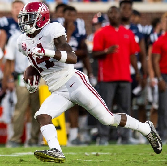 Alabama defensive back Deionte Thompson (14) returns an interception against Ole Miss In first half action in Oxford, Ms., on Saturday September 15, 2018.