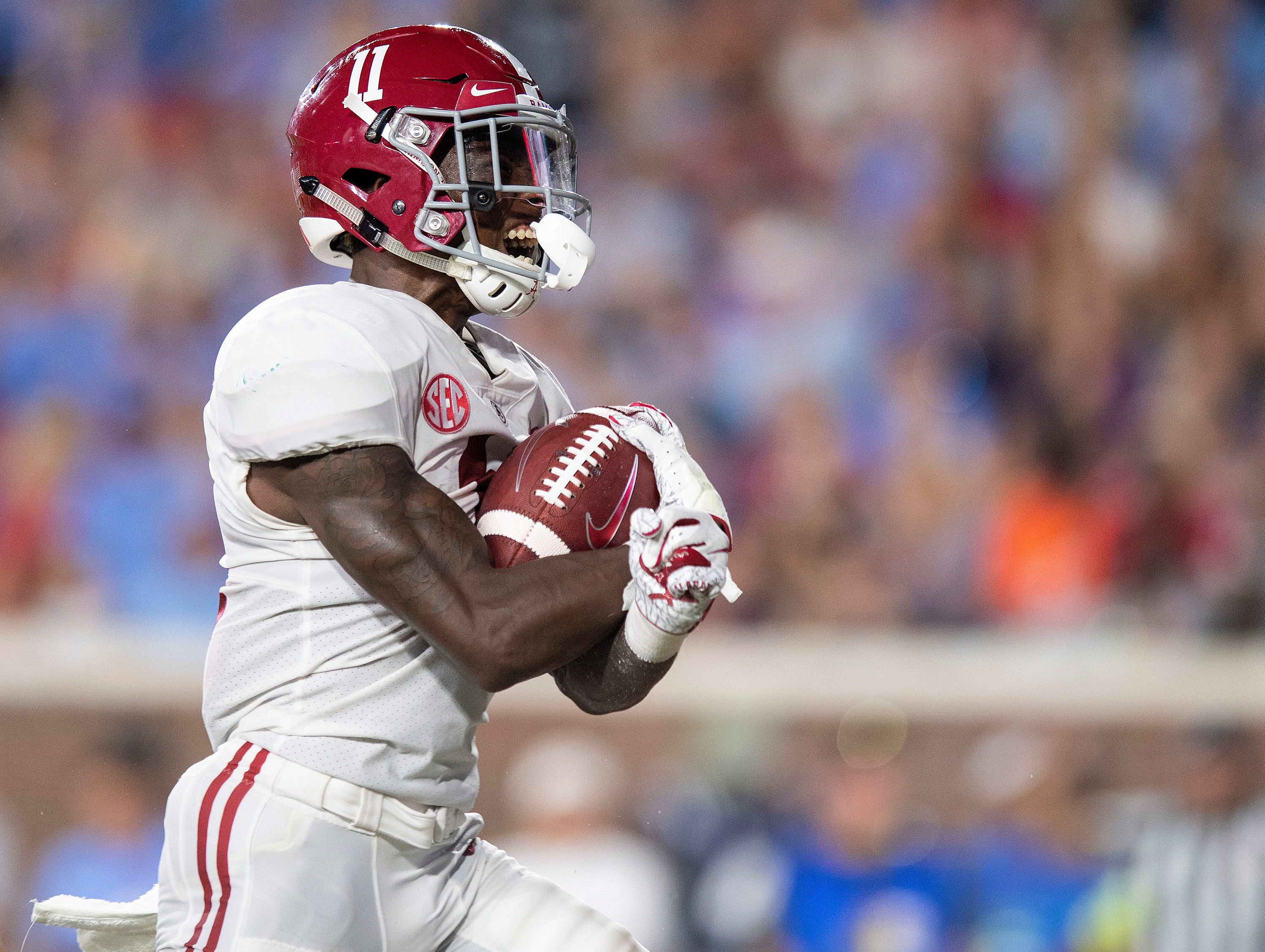 Alabama wide receiver Henry Ruggs, III, (11) scores a touchdown In first half action in Oxford, Ms., on Saturday September 15, 2018.