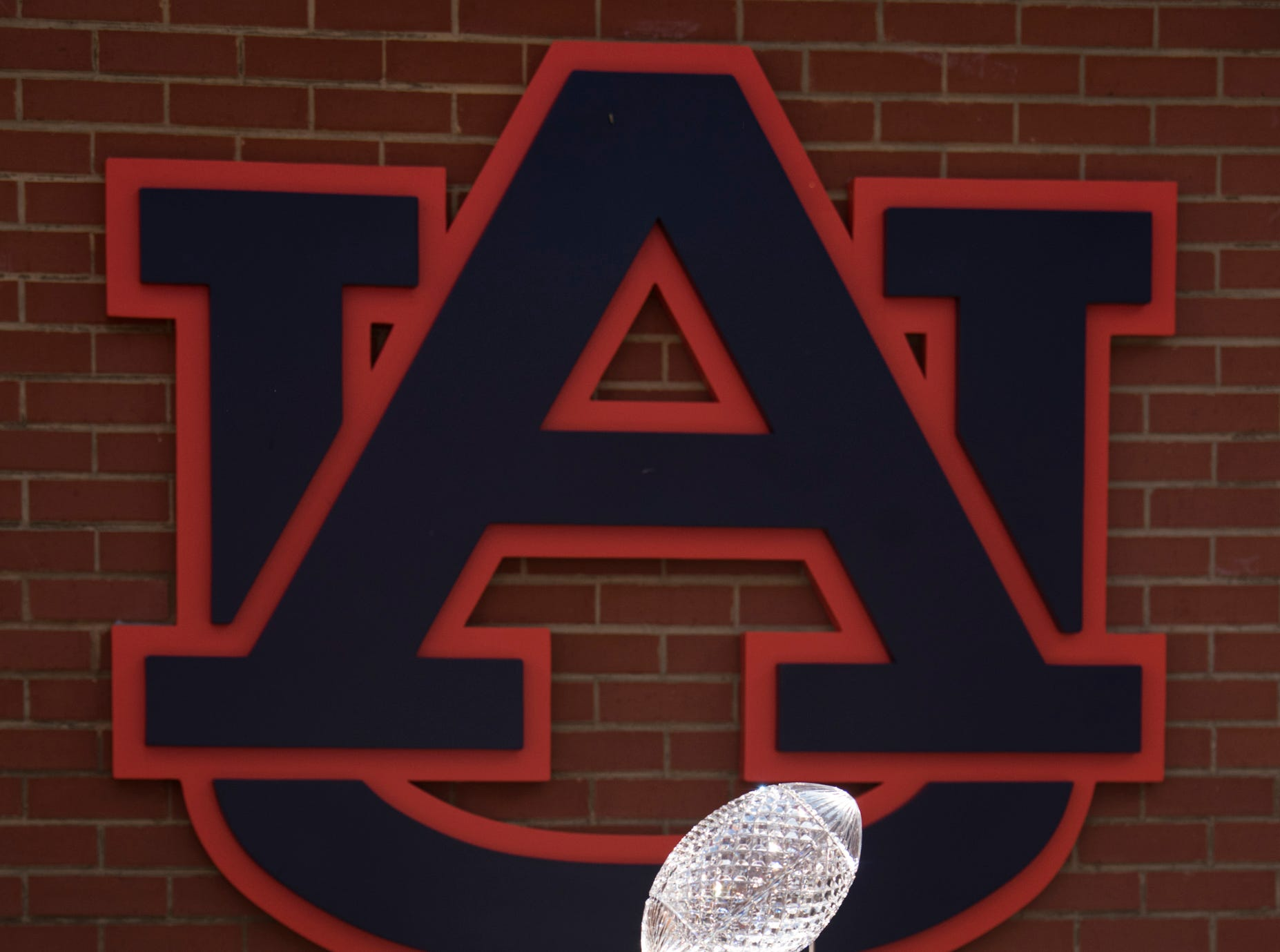 The coaches pool national championship trophy on the sidelines of the Auburn-LSU game at Jordan-Hare Stadium in Auburn, Ala., on Saturday, Sept. 15, 2018. LSU defeated Auburn 22-21.