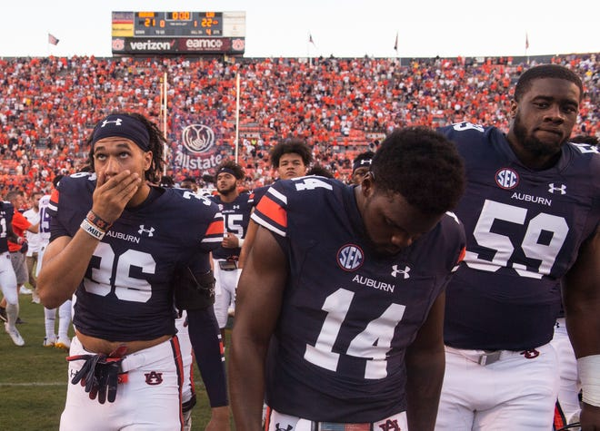Auburn players look shocked walking of the field after the game at Jordan-Hare Stadium in Auburn, Ala., on Saturday, Sept. 15, 2018. LSU defeated Auburn 22-21.