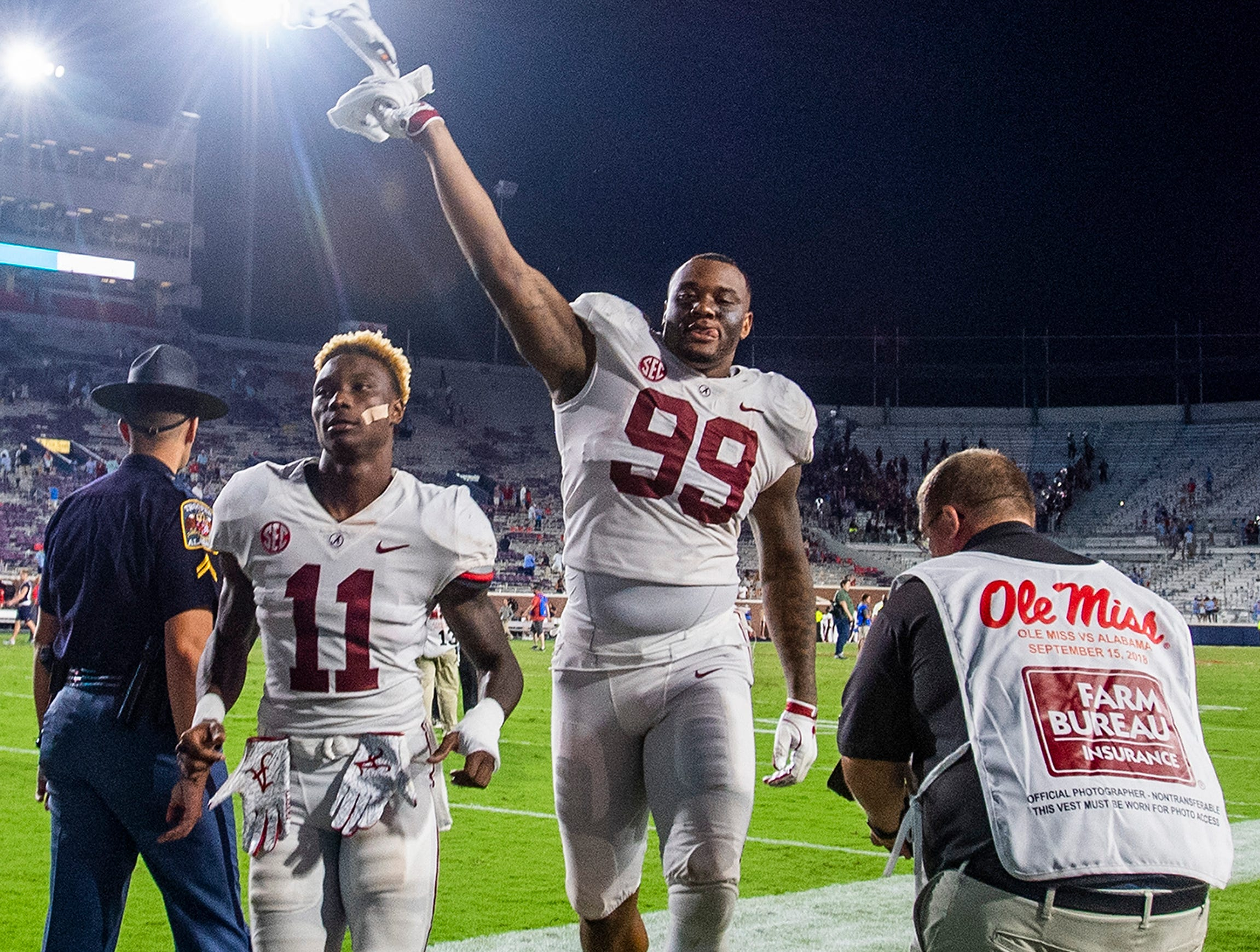 Alabama wide receiver Henry Ruggs, III, (11) and Alabama defensive lineman Raekwon Davis (99) leave the field after defeating Ole Miss in Oxford, Ms., on Saturday September 15, 2018.