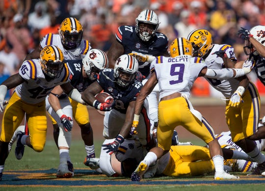 Auburn's JaTarvious Whitlow (28) fights through defenders at Jordan-Hare Stadium in Auburn, Ala., on Saturday, Sept. 15, 2018. LSU defeated Auburn 22-21.