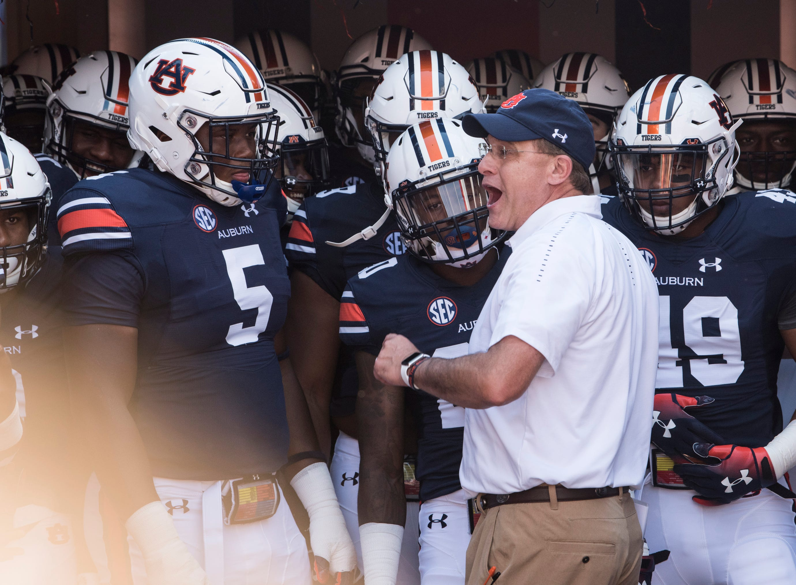 Auburn head coach Gus Malzahn leads his team out before taking on LSU at Jordan-Hare Stadium in Auburn, Ala., on Saturday, Sept. 15, 2018. LSU defeated Auburn 22-21.