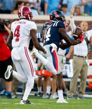 Ole Miss wide receiver D.K. Metcalf (14) catches a touchdown pass against Alabama linebacker Christopher Allen (4) on the first play from scrimmage against Alabama in Oxford, Ms., on Saturday September 15, 2018.