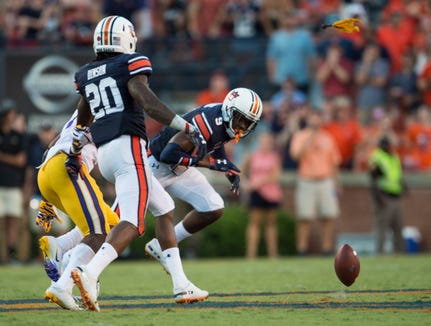 A flag is thrown on Auburn's Jeremiah Dinson (20) for pass interference on LSU's Jonathan Giles (7) during the final drive at Jordan-Hare Stadium in Auburn, Ala., on Saturday, Sept. 15, 2018. LSU defeated Auburn 22-21.
