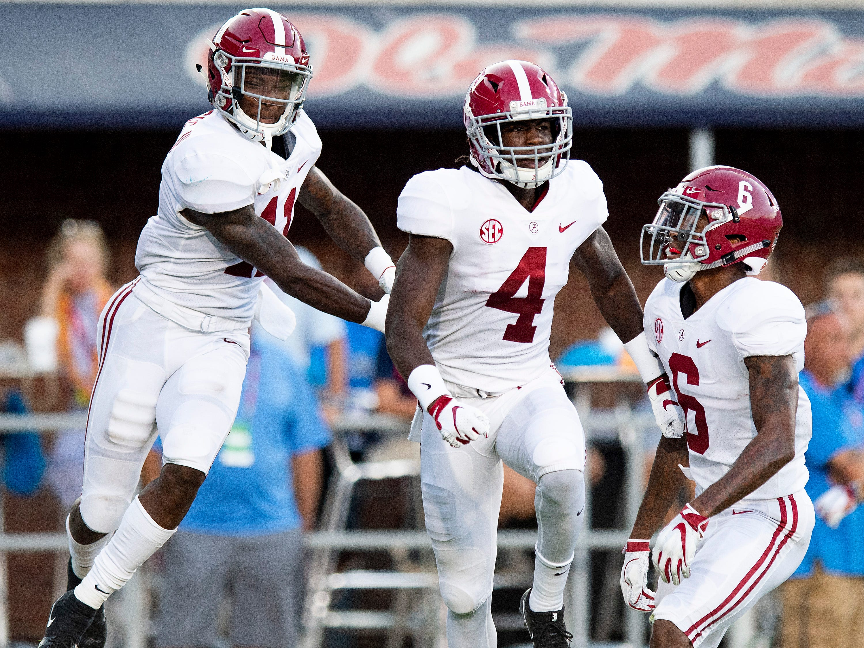 Alabama wide receivers Henry Ruggs, III, (11), Jerry Jeudy (4) and DeVonta Smith (6) celebrate Jeudy's touchdown In first half action in Oxford, Ms., on Saturday September 15, 2018.