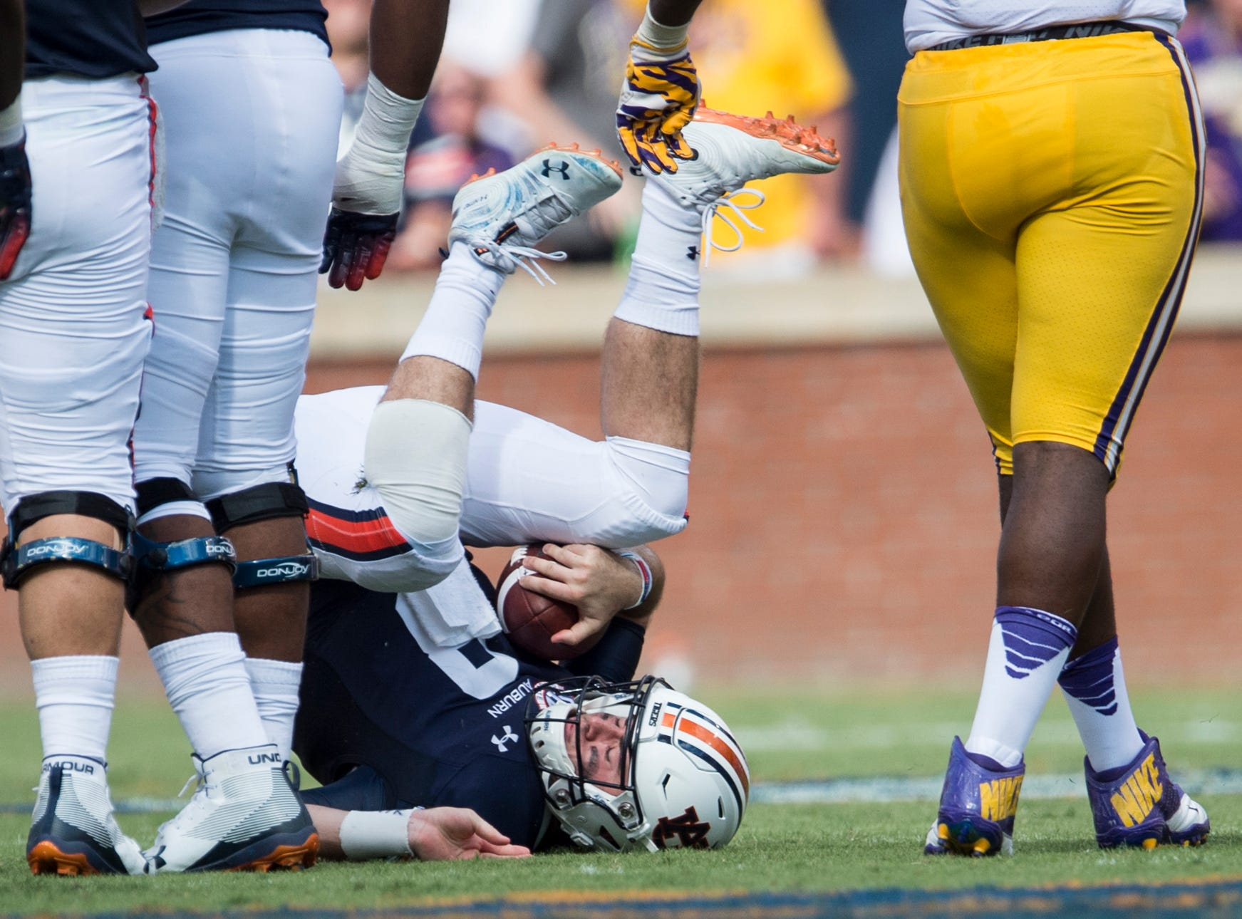 Auburn's Jarrett Stidham (8) rolls on his back after being sacked by LSU at Jordan-Hare Stadium in Auburn, Ala., on Saturday, Sept. 15, 2018. LSU defeated Auburn 22-21.