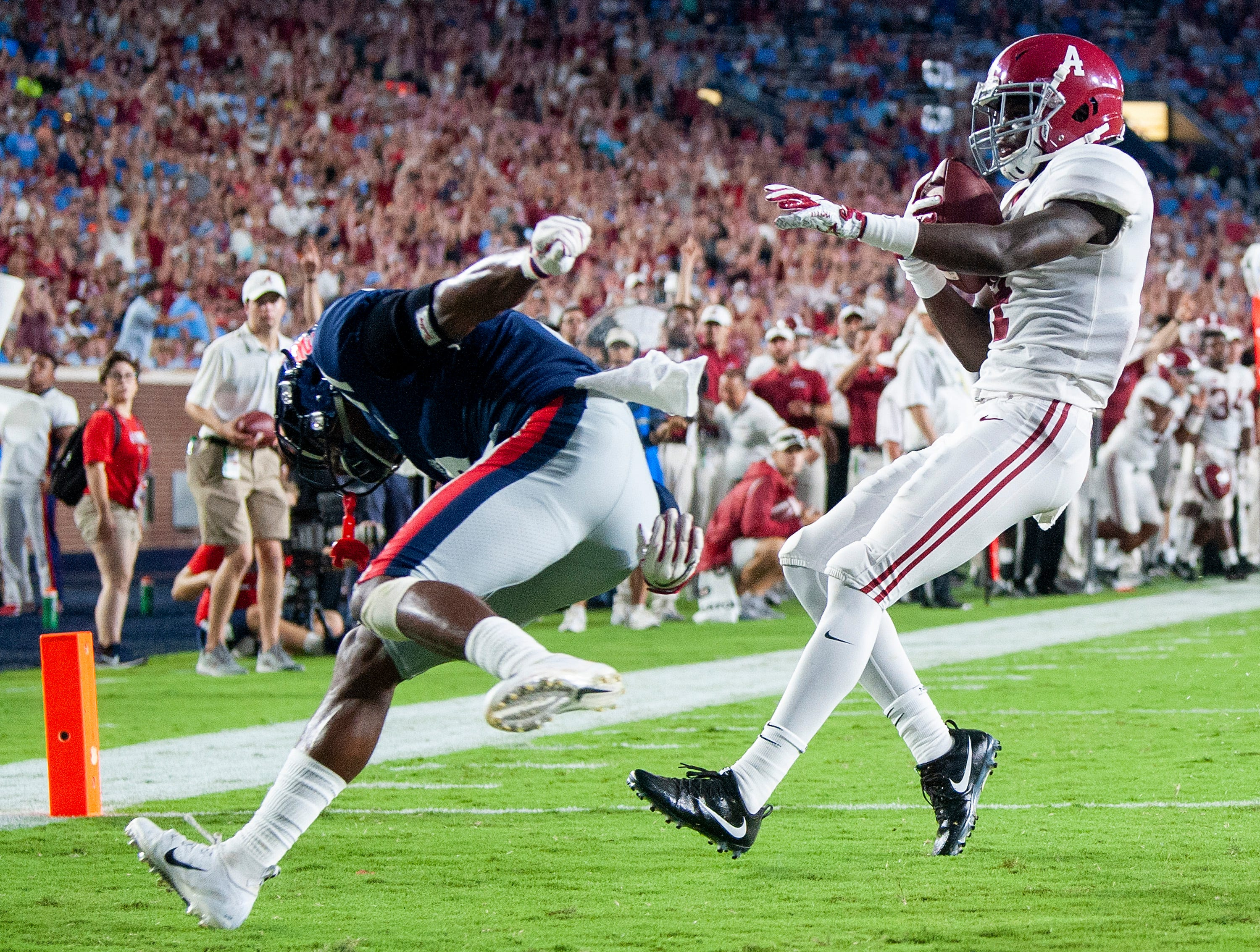 Alabama wide receiver Jerry Jeudy (4) scores a touchdown against Ole Miss defensive back Montrell Custis (2) In first half action in Oxford, Ms., on Saturday September 15, 2018.
