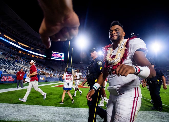 Alabama quarterback Tua Tagovailoa (13) gets a fist bump as he walks off the field after defeating Ole Miss in Oxford, Ms., on Saturday September 15, 2018.