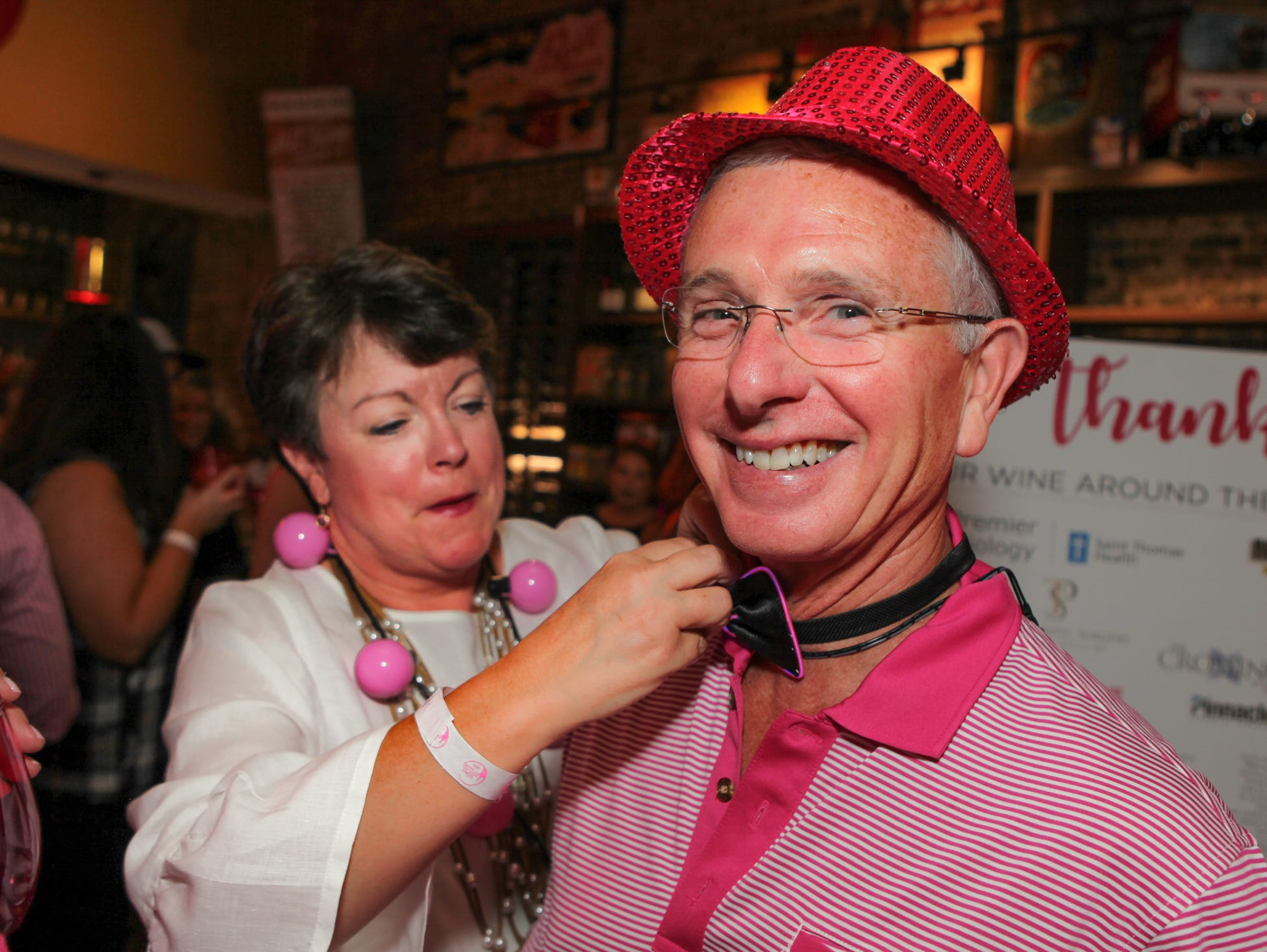 Cindy Fergusen fixes Gordon Fergusen's bow tie at Wine Around the Square, Saint Thomas Rutherford Foundation's Power of Pink fundraiser to fight breast cancer, on Saturday, Sept. 15, 2018.