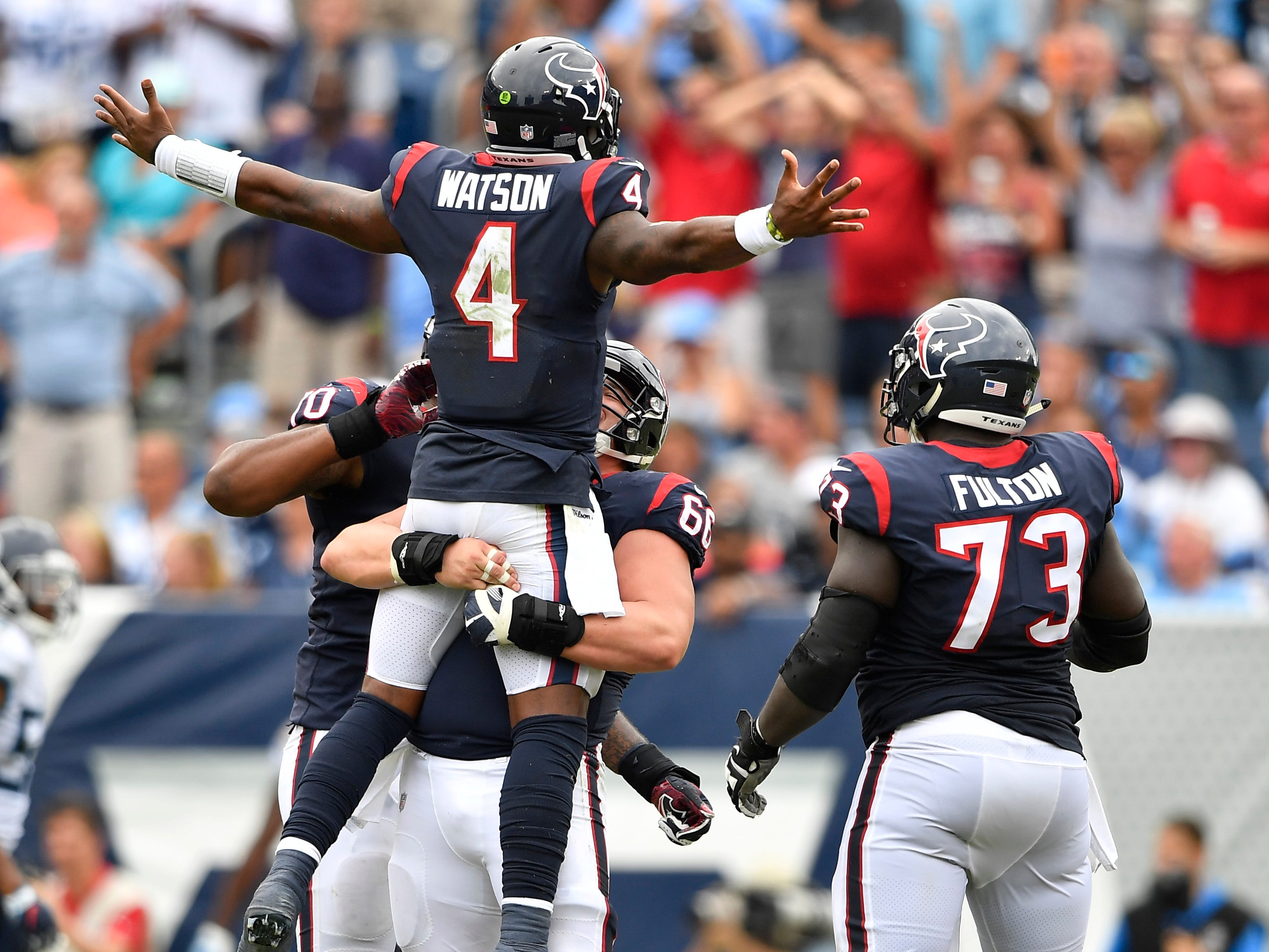 Texans quarterback Deshaun Watson (4) celebrates his touchdown pass with Texans center Nick Martin (66) in the fourth quarter at Nissan Stadium Sunday, Sept. 16, 2018, in Nashville, Tenn.