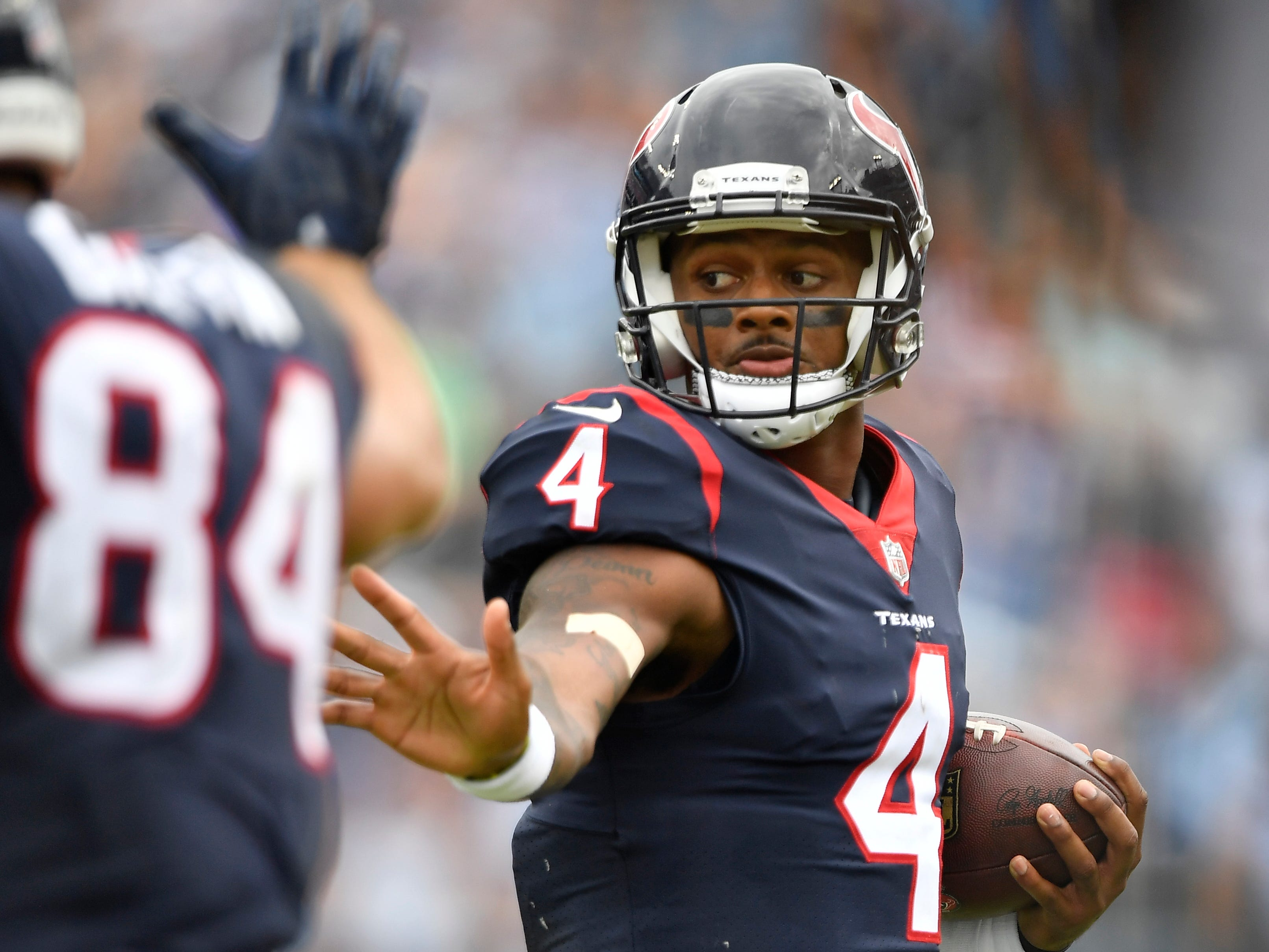 Texans quarterback Deshaun Watson (4) scrambles out of the pocket in the third quarter at Nissan Stadium Sunday, Sept. 16, 2018, in Nashville, Tenn.