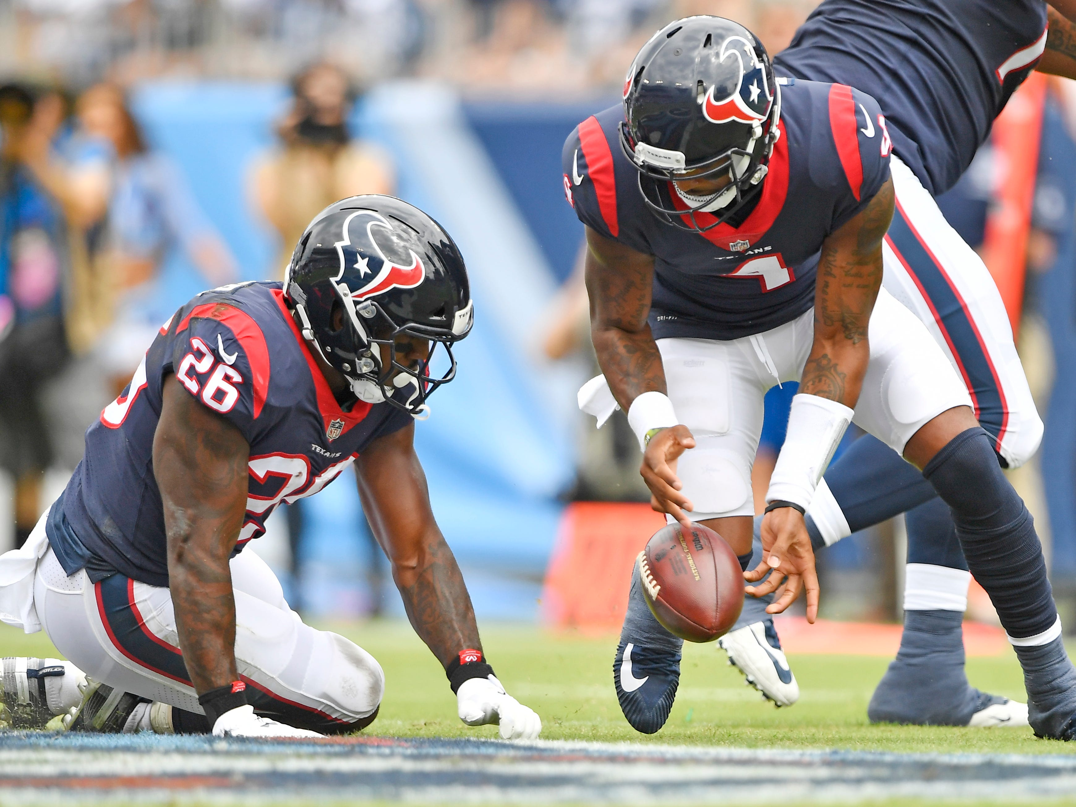 Texans quarterback Deshaun Watson (4) fumbles the snap in the first half at Nissan Stadium Sunday, Sept. 16, 2018, in Nashville, Tenn.