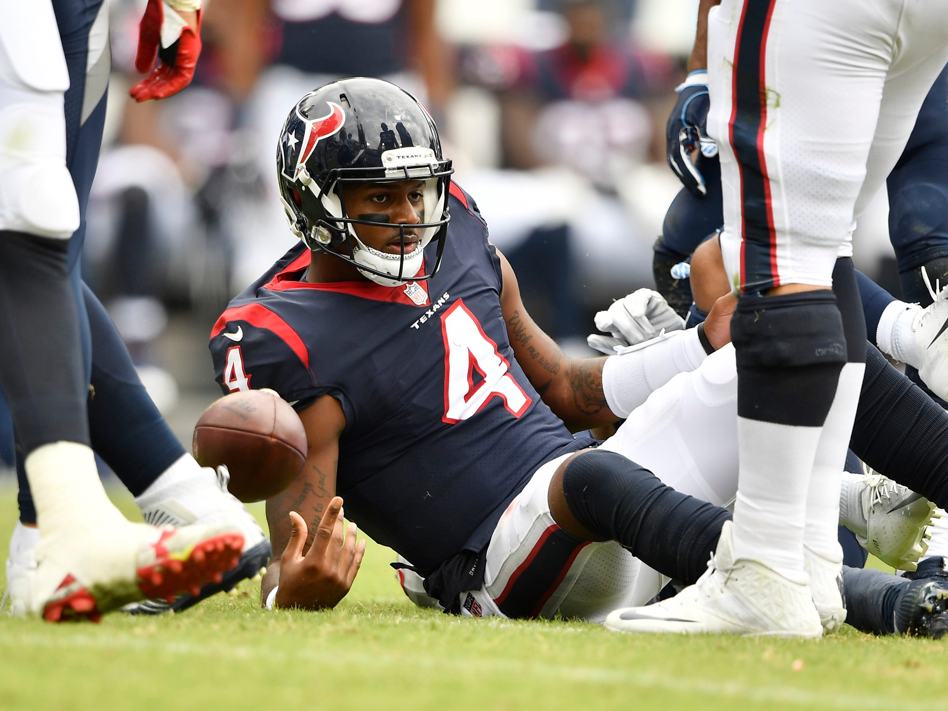 Texans quarterback Deshaun Watson (4) is sacked by Titans linebacker Kamalei Correa (44) in the second half at Nissan Stadium Sunday, Sept. 16, 2018, in Nashville, Tenn.