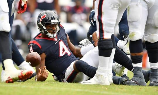Texans quarterback Deshaun Watson (4) is sacked by Titans linebacker Kamalei Correa (44) in the second half at Nissan Stadium on Sunday.