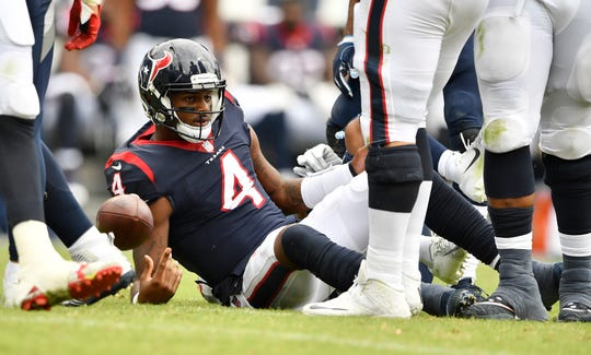 Texans quarterback Deshaun Watson (4) is sacked by Titans linebacker Kamalei Correa (44) in the second half at Nissan Stadium on Sunday.