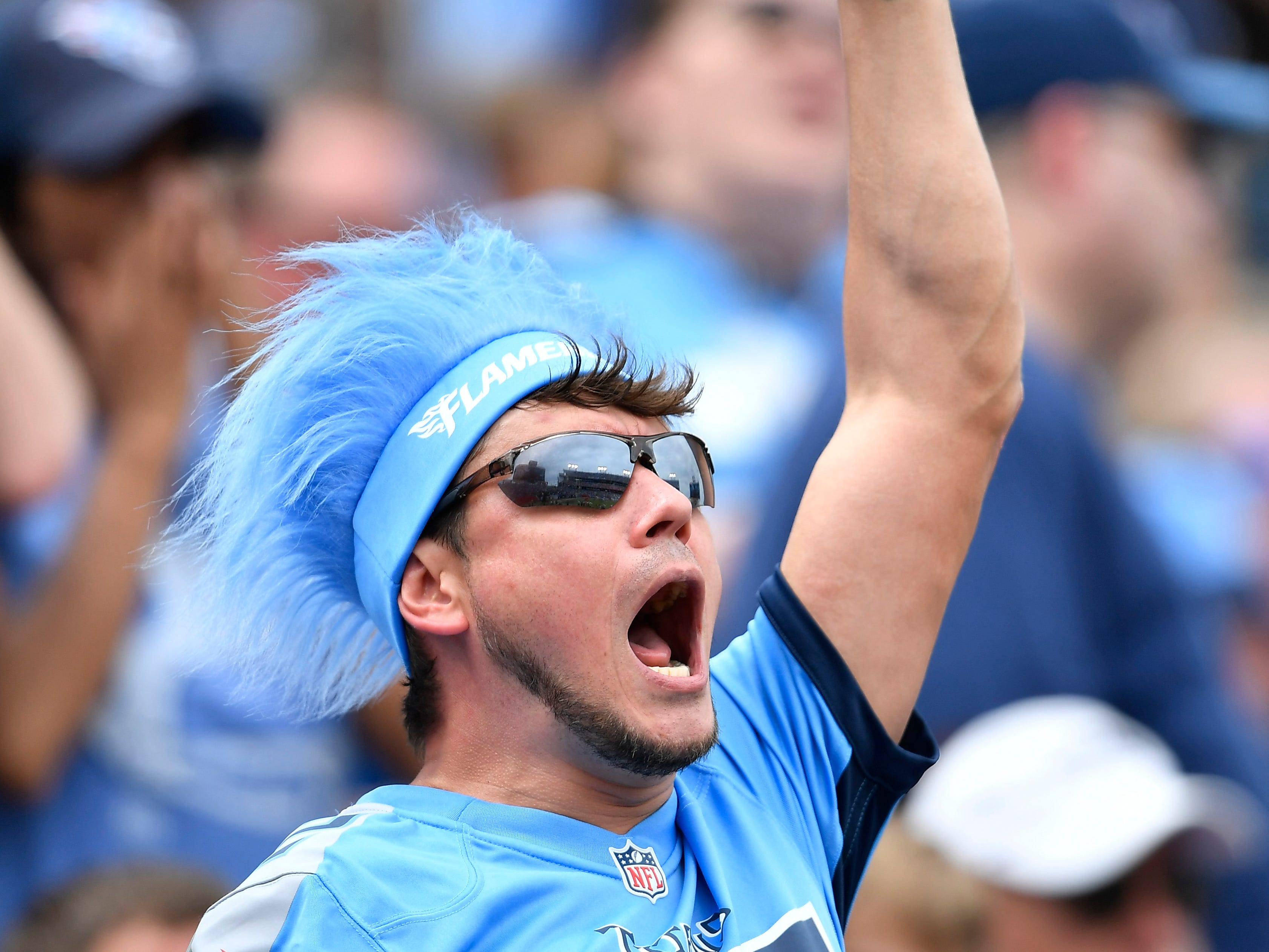 A Titans fan yells for the team at the start of the second half at Nissan Stadium Sunday, Sept. 16, 2018, in Nashville, Tenn.