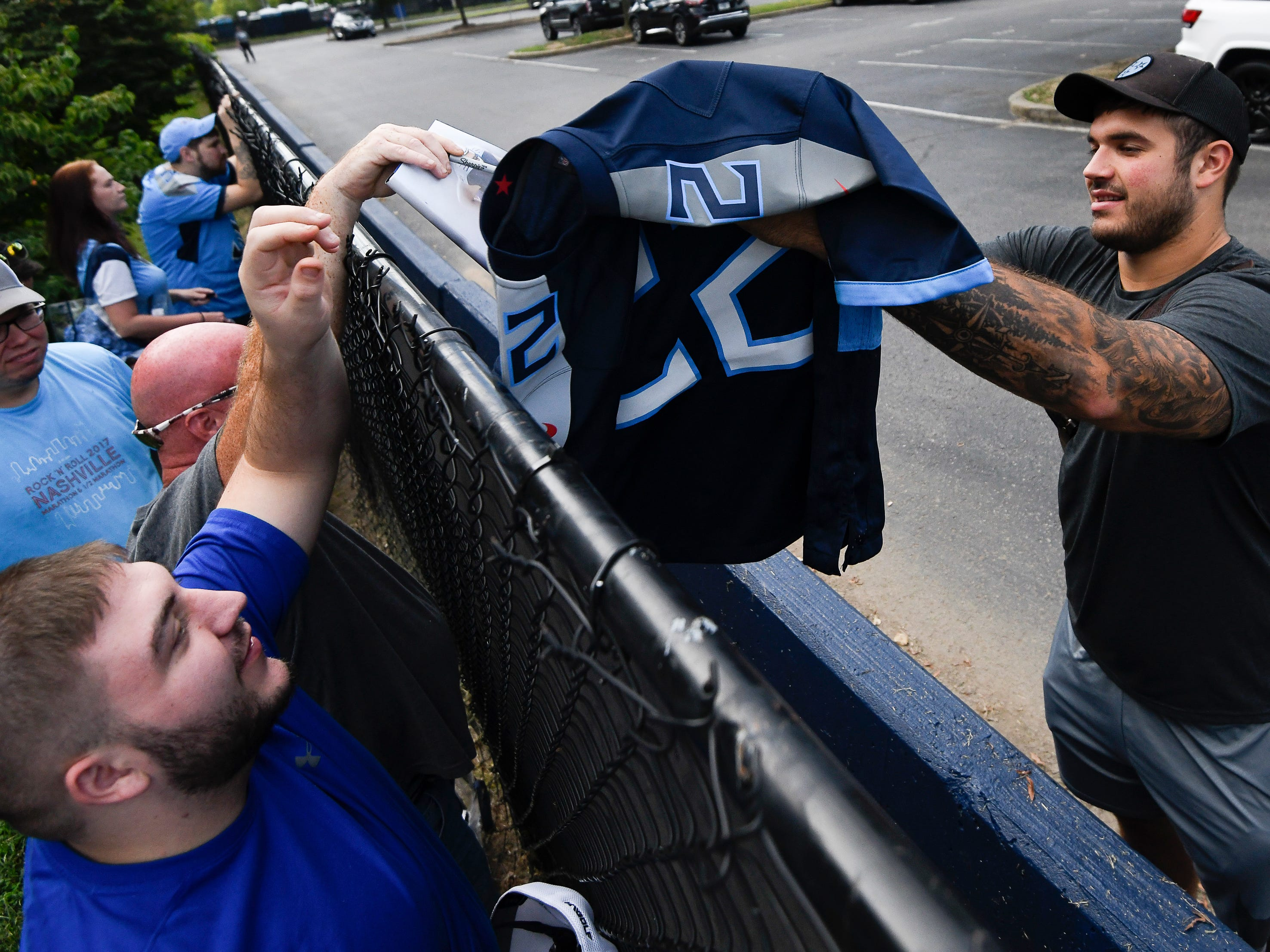 Titans offensive tackle Jack Conklin signs autographs for fans before their game against the Texans at Nissan Stadium Sunday, Sept. 16, 2018, in Nashville, Tenn.
