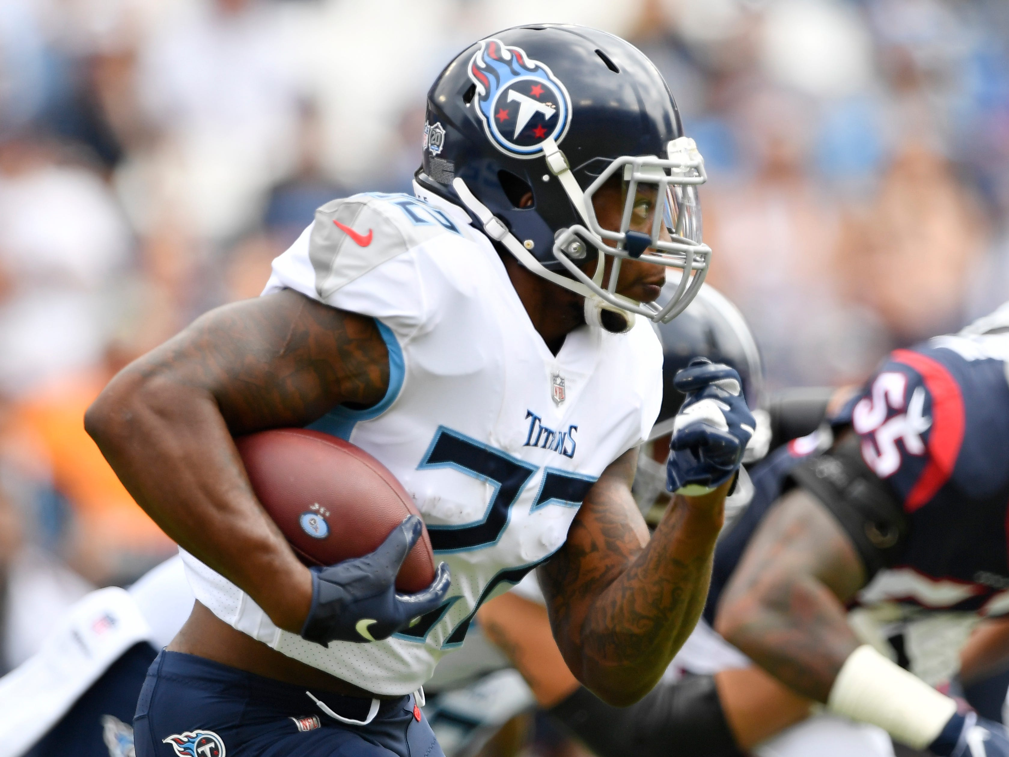 Titans running back Derrick Henry (22) moves the ball in the first quarter at Nissan Stadium Sunday, Sept. 16, 2018, in Nashville, Tenn.