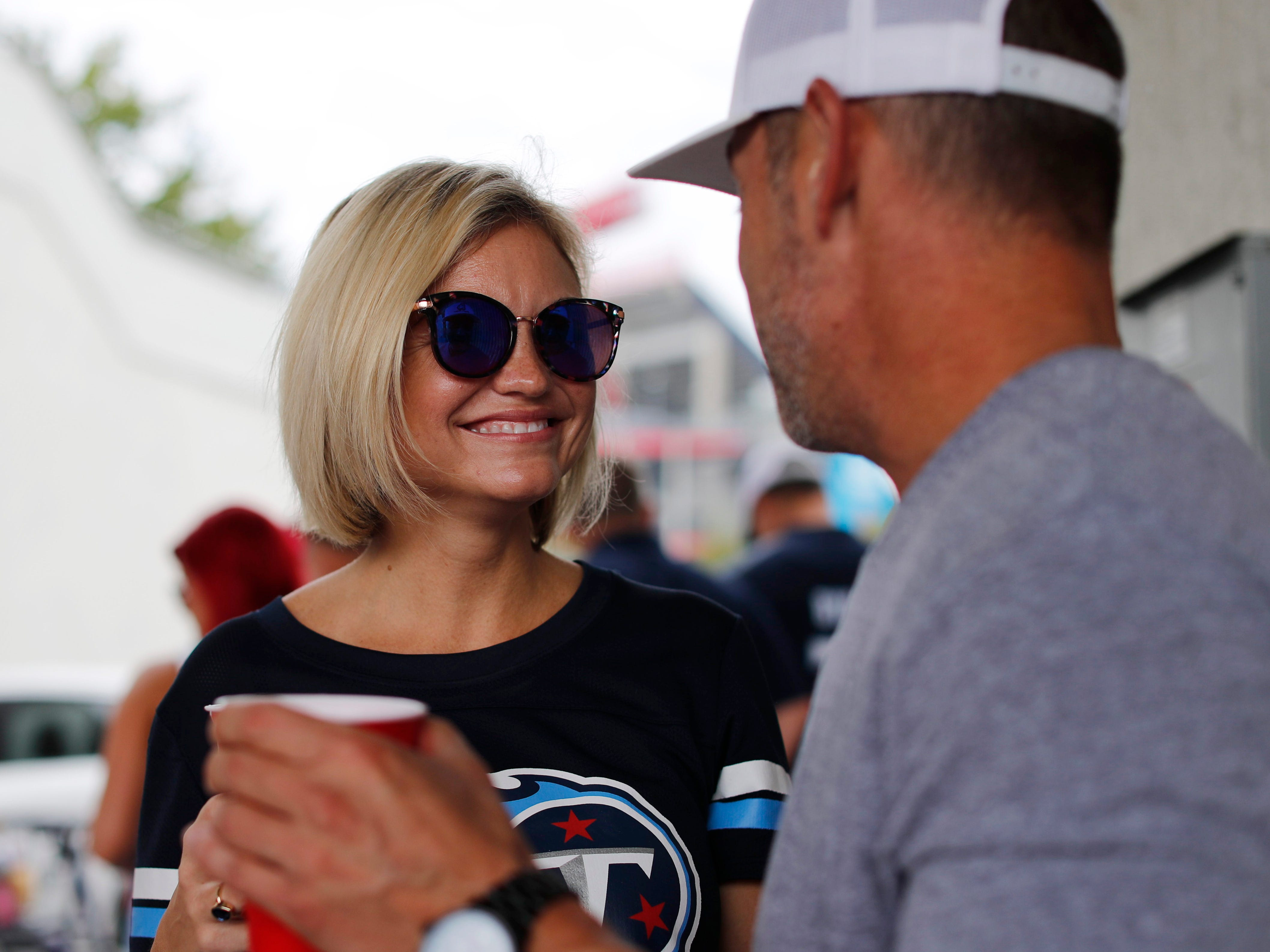Angela McAndrew and William Morstad tailgate before the Titans' game against the Texans at Nissan Stadium Sunday, Sept. 16, 2018, in Nashville, Tenn.