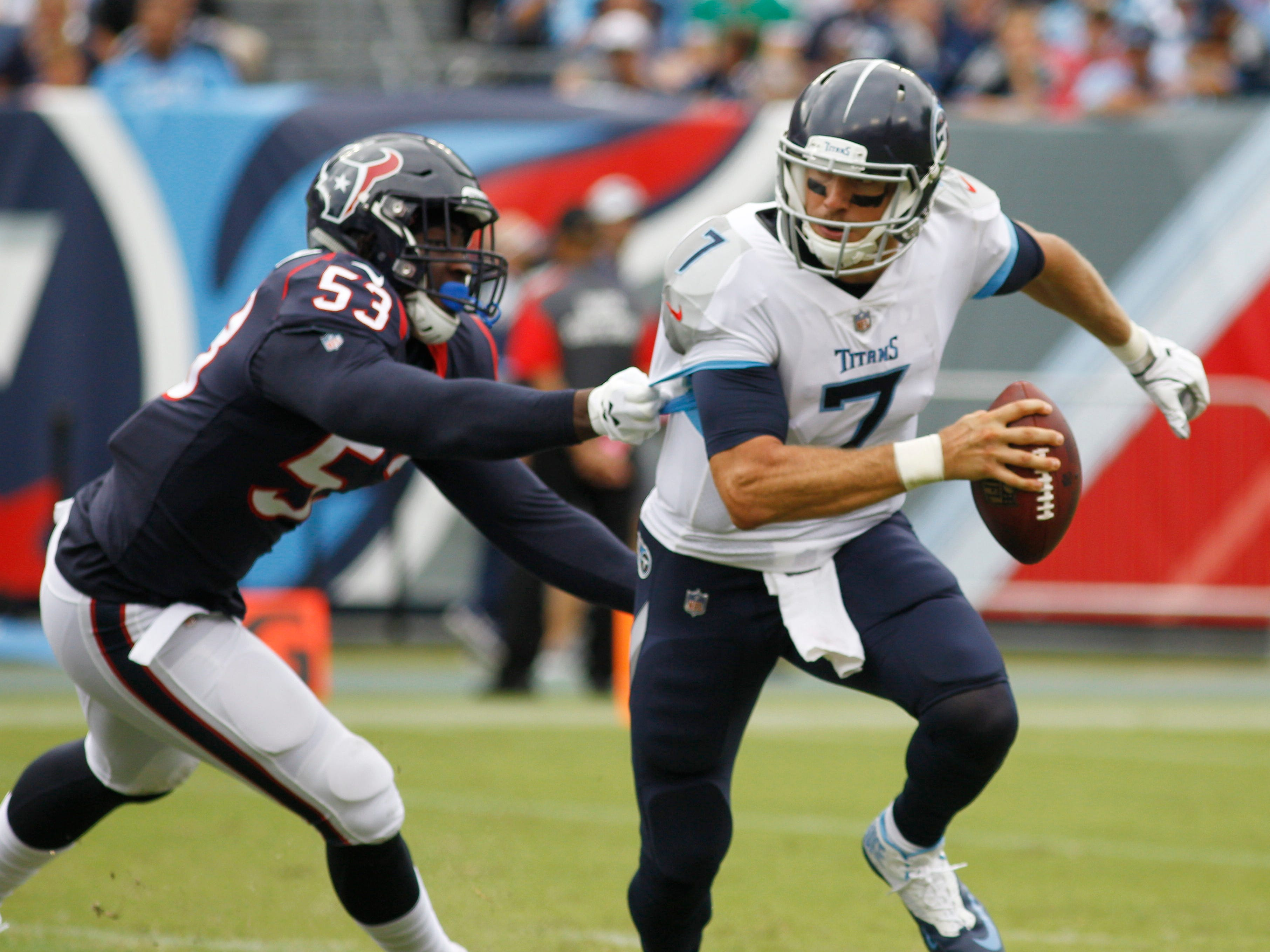 Biggest surprise: Titans beat Texans without Mariota -- Texans linebacker Duke Ejiofor (53) hangs onto as Titans quarterback Blaine Gabbert (7) scrambles in the third quarter at Nissan Stadium Sunday, Sept. 16, 2018, in Nashville, Tenn.