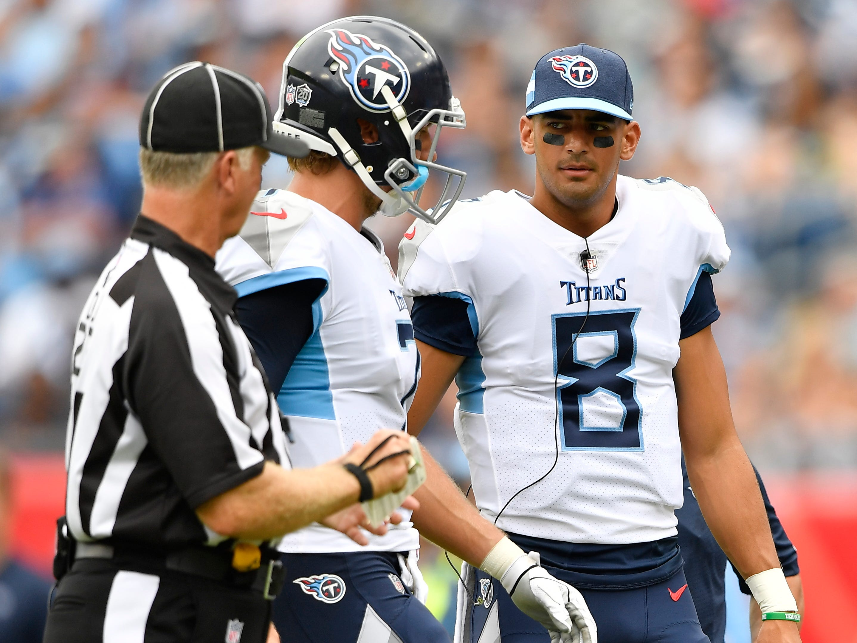 Titans quarterback Marcus Mariota (8) greets quarterback Blaine Gabbert (7) when he comes off the field in the second half at Nissan Stadium Sunday, Sept. 16, 2018, in Nashville, Tenn.
