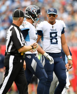 Marcus Mariota (8) greets his backup, Blaine Gabbert, as the latter comes off the field during the second half against the Texans on Sunday. With Mariota hurt, Gabbert got the start and helped guide the Titans to a win over their AFC South rivals.