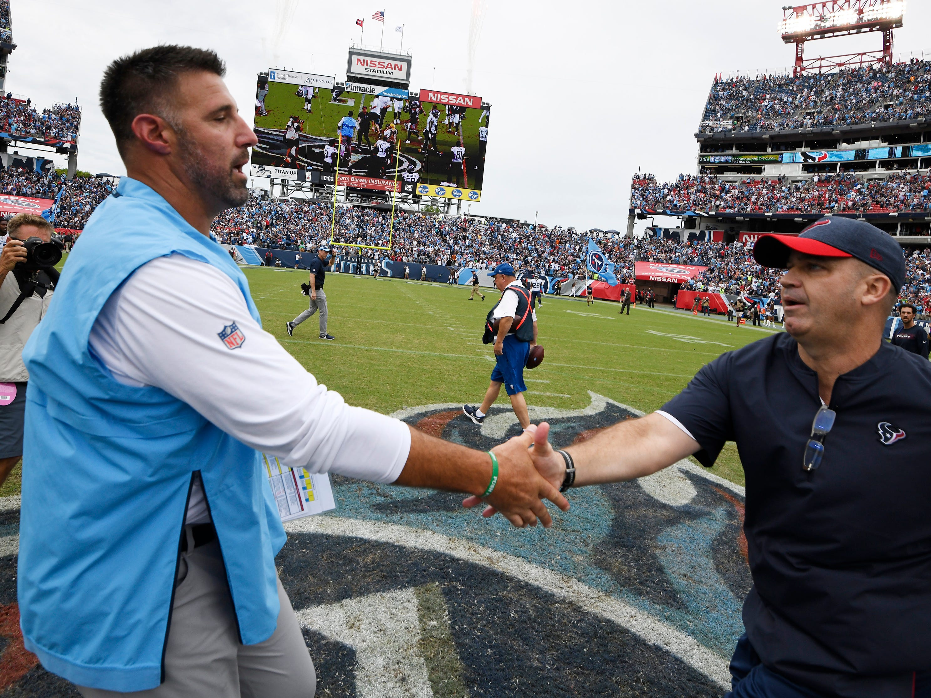 Titans head coach Mike Vrabel shakes hands with Texans head coach Bill O'Brien after the Titans' 20-17 win at Nissan Stadium Sunday, Sept. 16, 2018, in Nashville, Tenn.