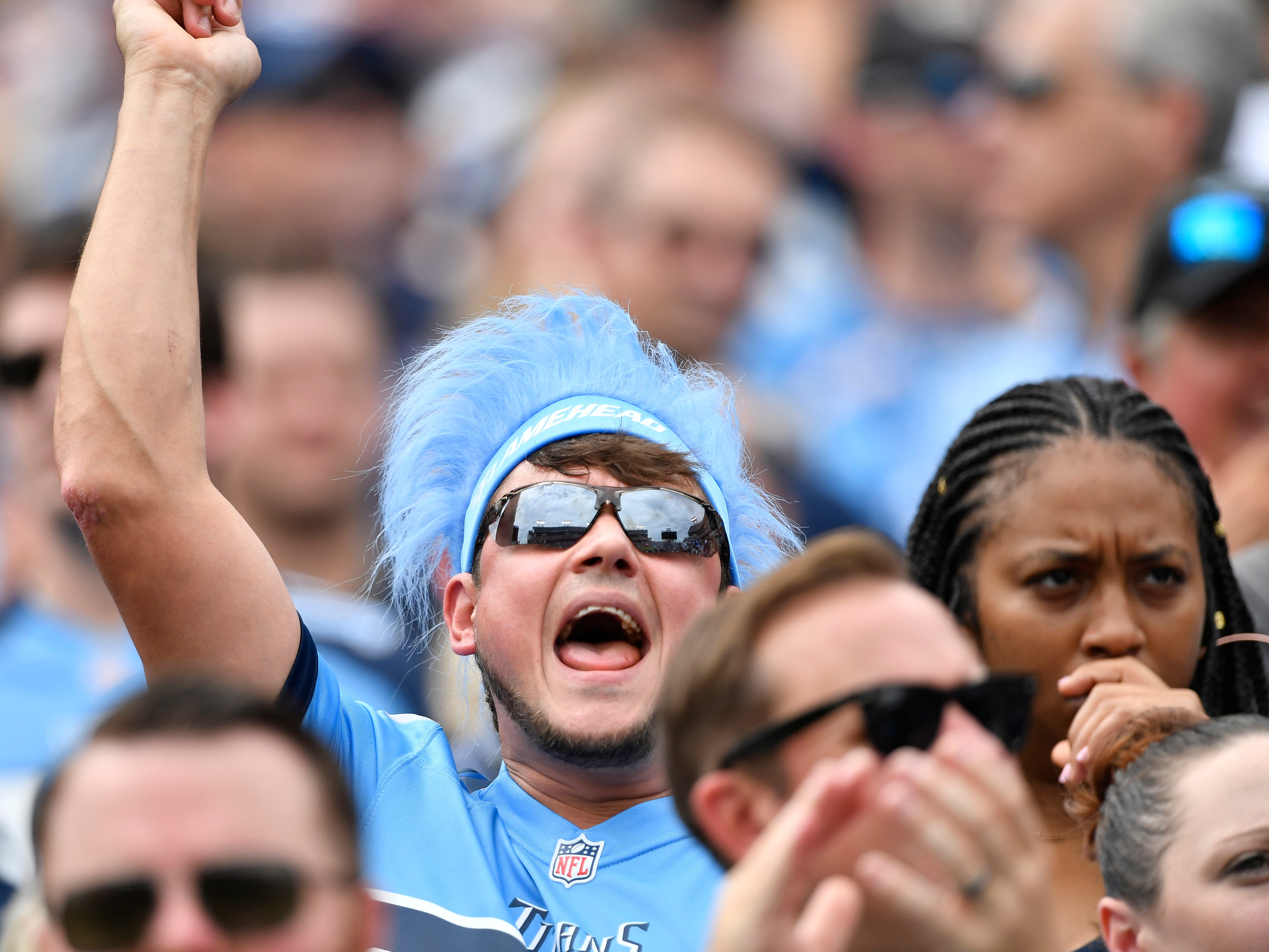 A Titans fan yells for his team in the first half at Nissan Stadium Sunday, Sept. 16, 2018, in Nashville, Tenn.