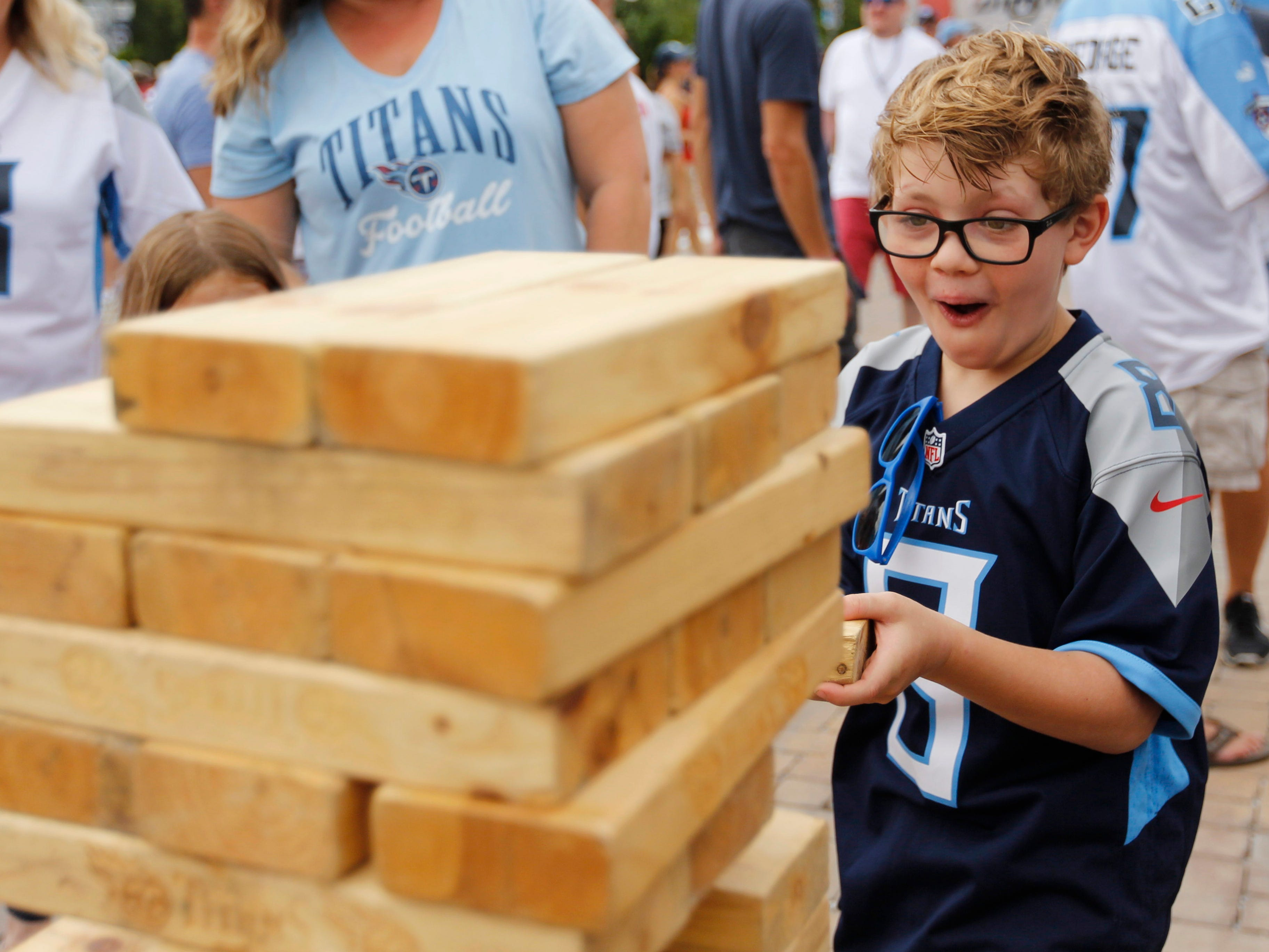 Conner Wilson is excited while he plays Jenga before the game at Nissan Stadium Sunday, Sept. 16, 2018, in Nashville, Tenn.