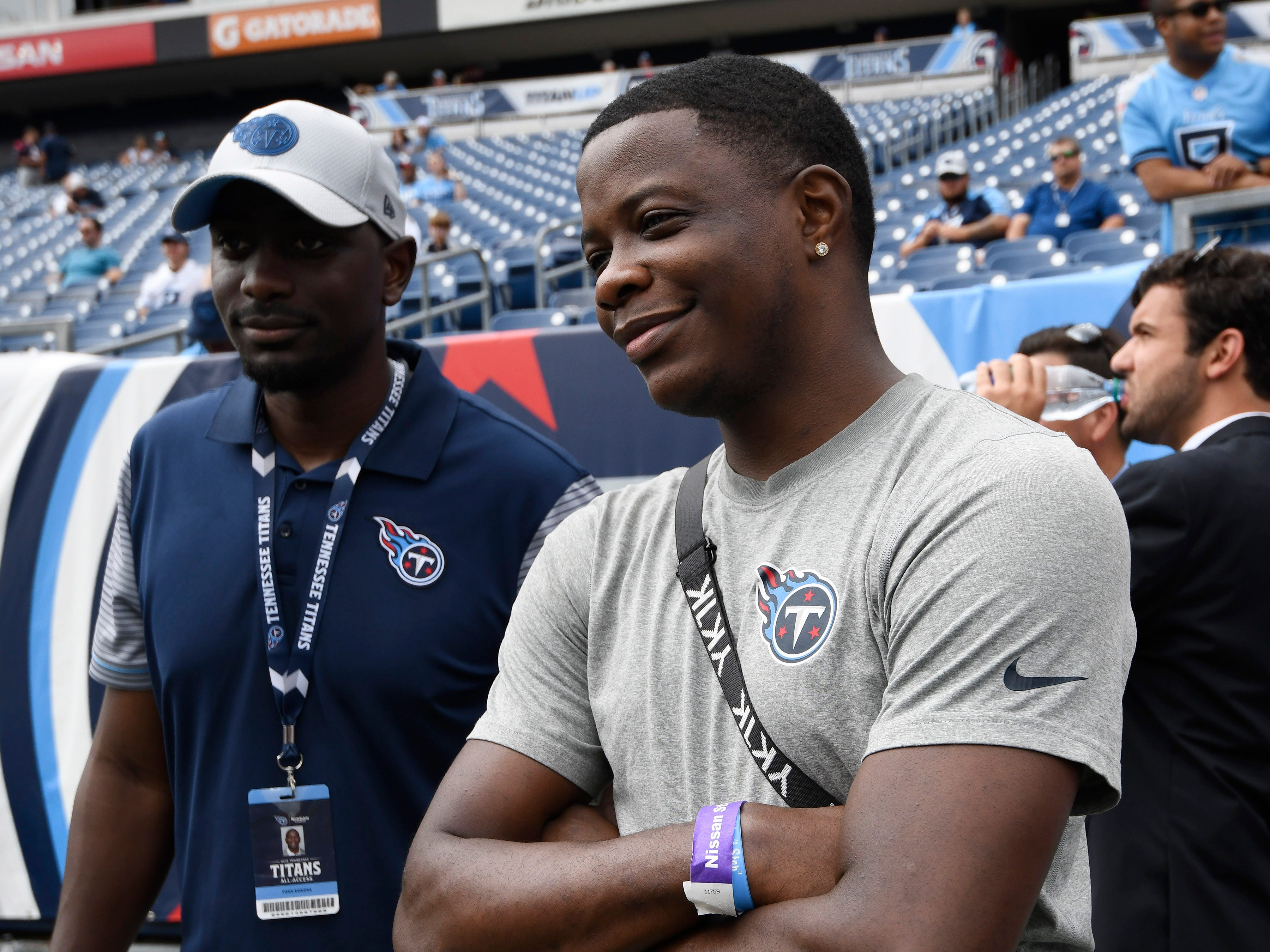 Waffle House shooting hero James Shaw Jr. watches the Titans warm up before the game against the Texans at Nissan Stadium Sunday, Sept. 16, 2018, in Nashville, Tenn.