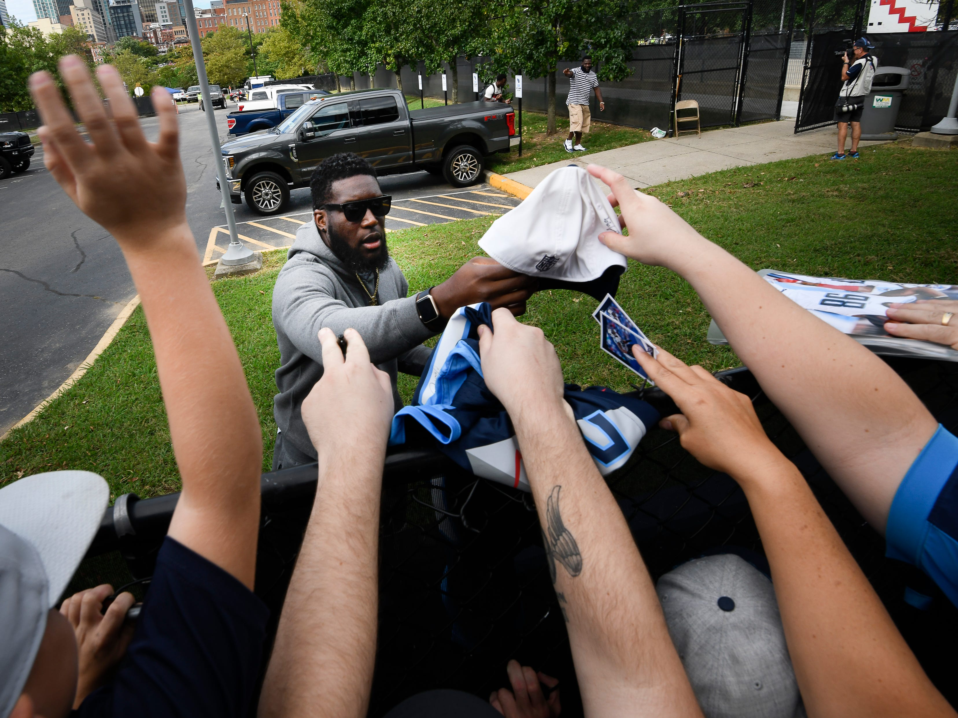 Titans linebacker Brian Orakpo signs autographs for fans before their game against the Texans at Nissan Stadium Sunday, Sept. 16, 2018, in Nashville, Tenn.