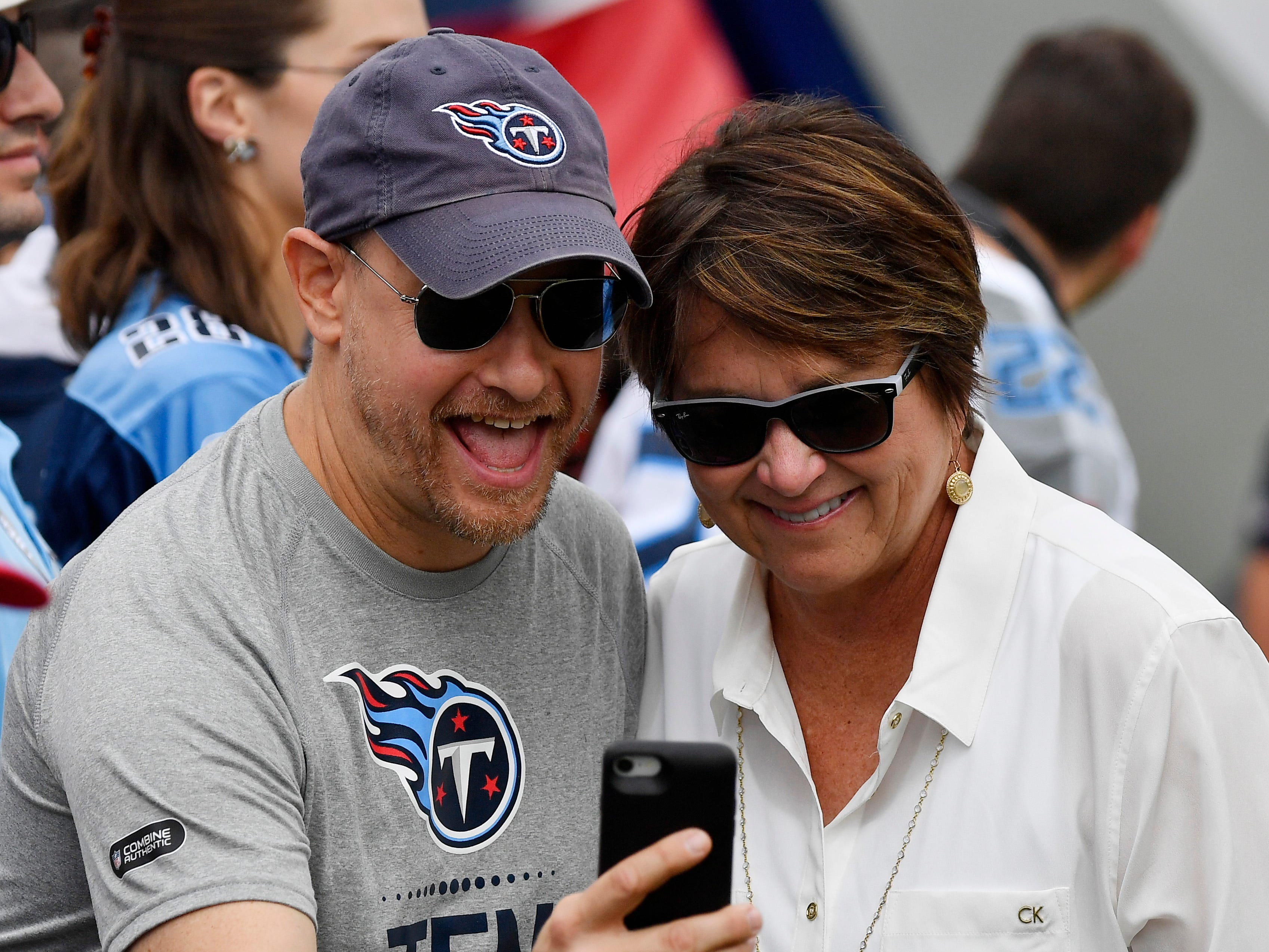Titans owner Amy Adams Struck takes a selfie with a fan before the game at Nissan Stadium Sunday, Sept. 16, 2018, in Nashville, Tenn.