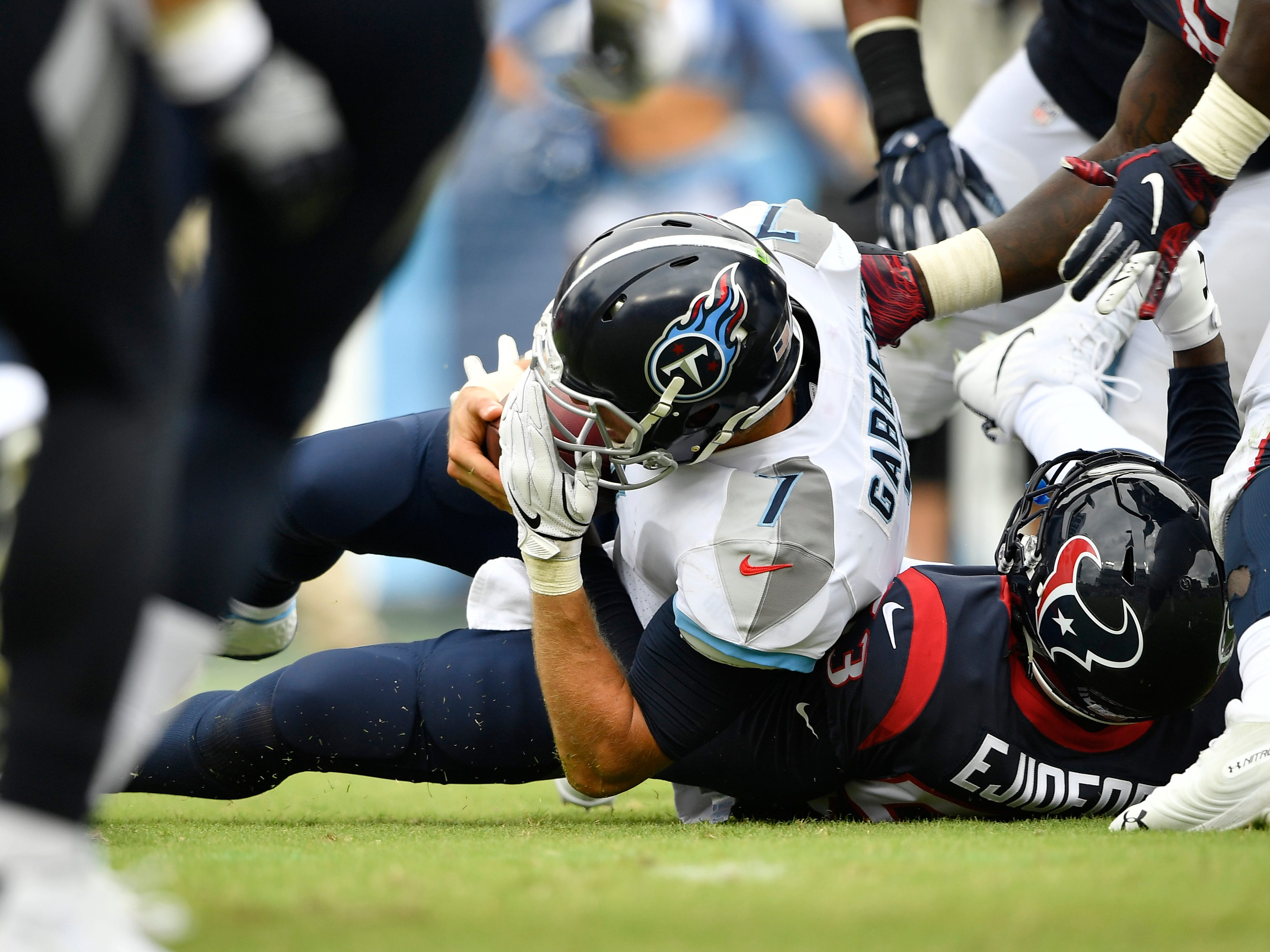 Titans quarterback Blaine Gabbert (7) is sacked in the third quarter at Nissan Stadium Sunday, Sept. 16, 2018, in Nashville, Tenn.