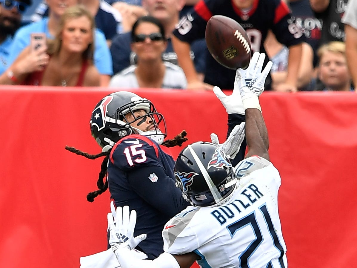 Texans wide receiver Will Fuller V (15) pulls down a touchdown pass over Titans cornerback Malcolm Butler (21) in the fourth quarter at Nissan Stadium Sunday, Sept. 16, 2018, in Nashville, Tenn.