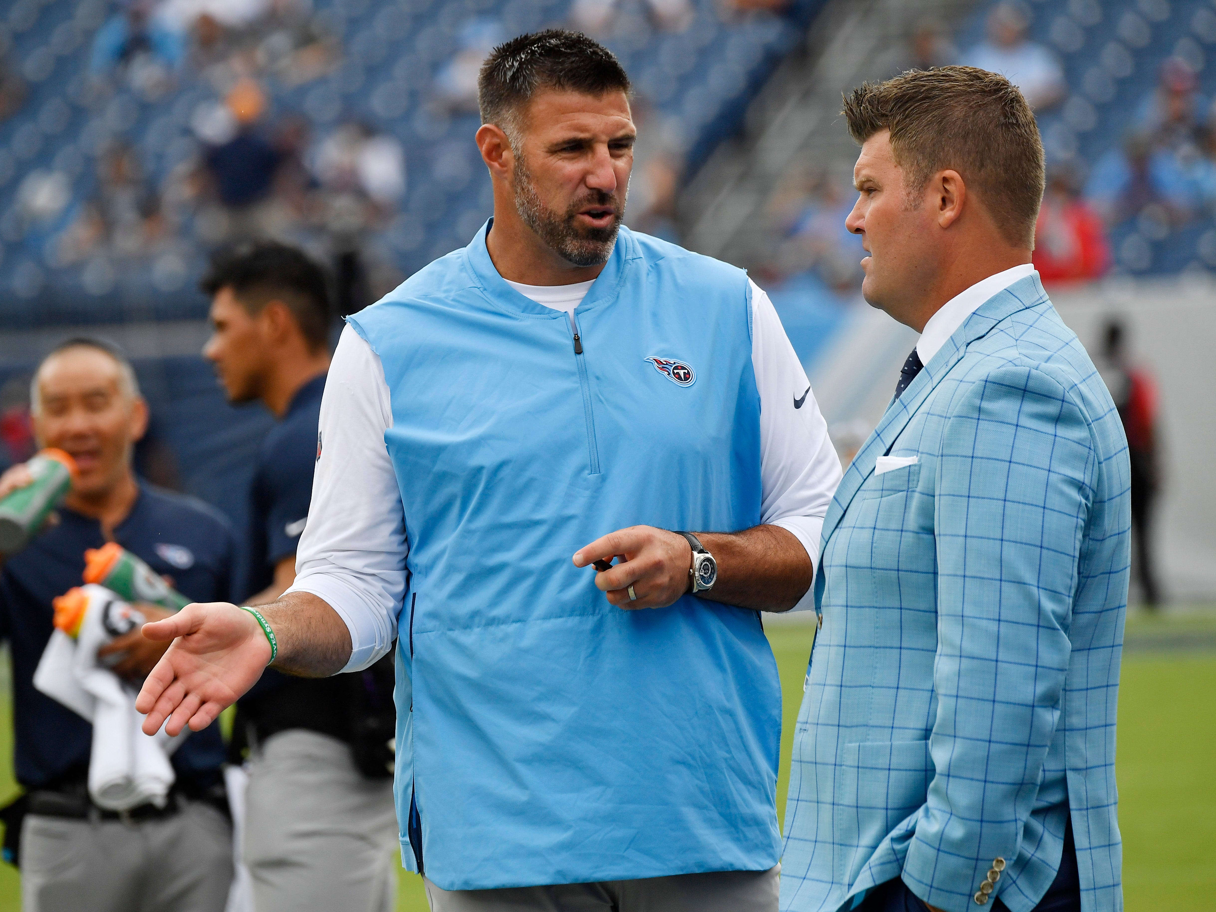 Titans head coach Mike Vrabel and General Manager Jon Robinson chat before the game at Nissan Stadium Sunday, Sept. 16, 2018, in Nashville, Tenn.