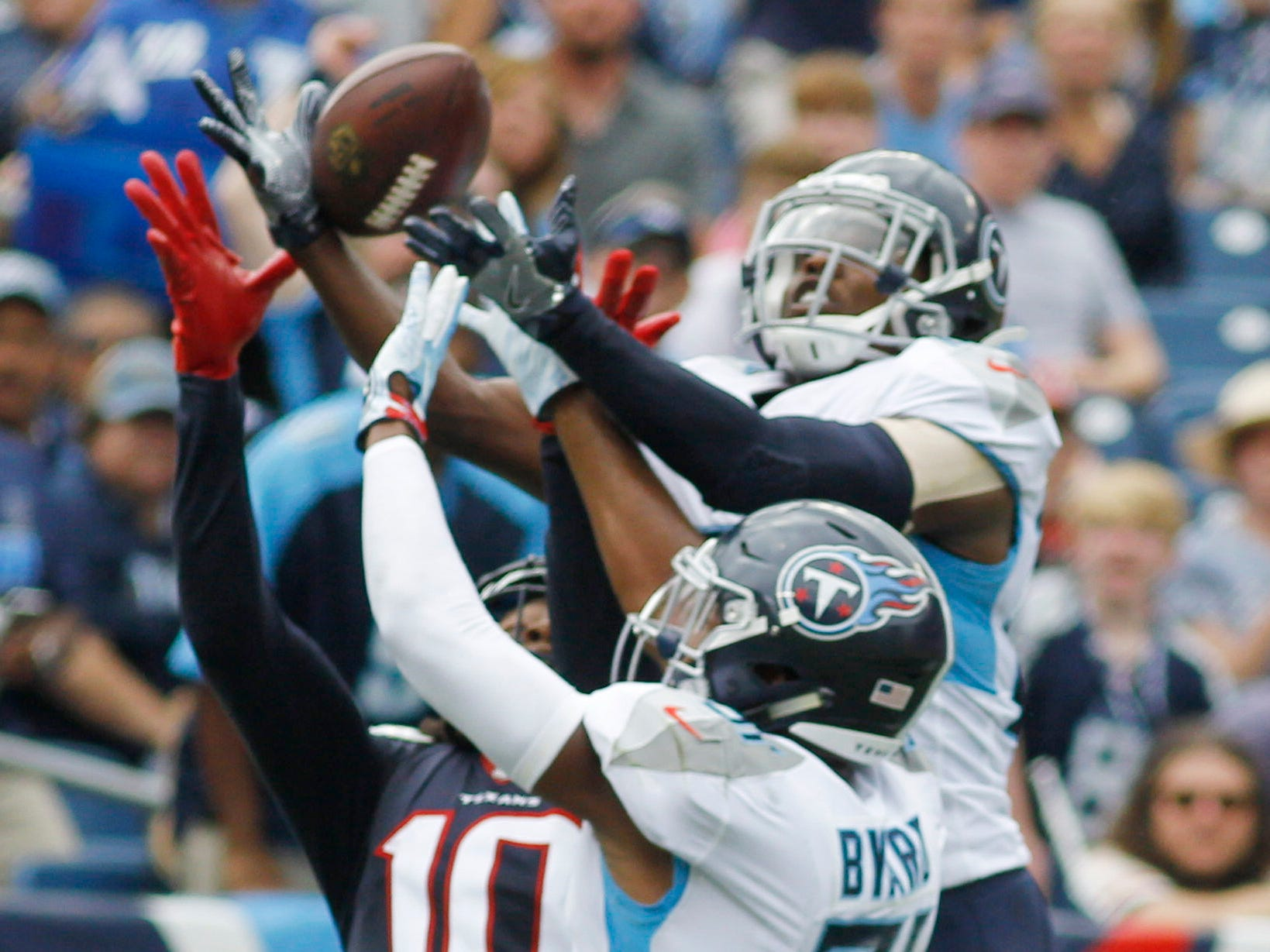 Titans cornerback Adoree' Jackson (25) goes up to grab an interception of a pass intended for Texans wide receiver DeAndre Hopkins (10) in the second quarter at Nissan Stadium Sunday, Sept. 16, 2018, in Nashville, Tenn.