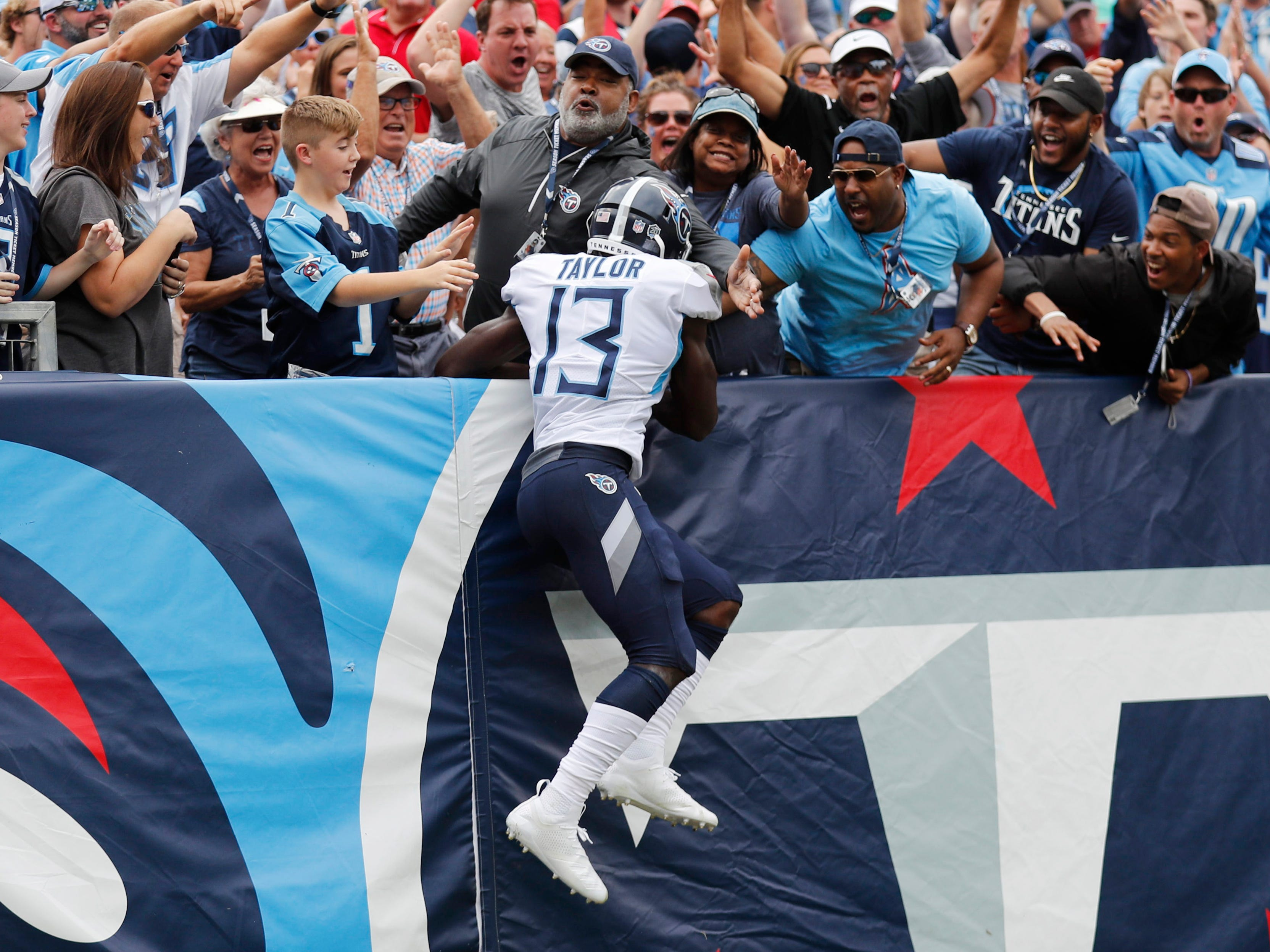 Titans wide receiver Taywan Taylor (13) celebrates with fans after scoring the team's second touchdown in the first half at Nissan Stadium Sunday, Sept. 16, 2018, in Nashville, Tenn.