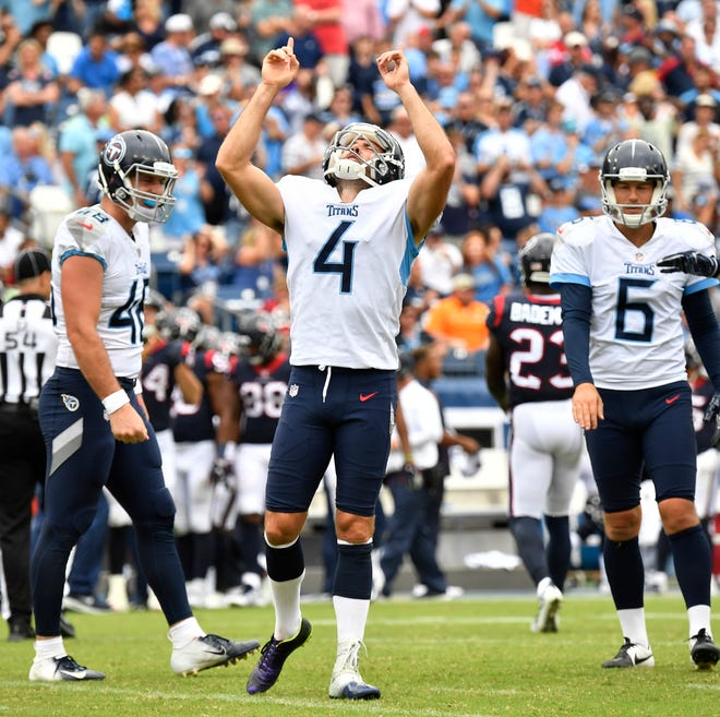 Titans placekicker Ryan Succop (4) celebrates his field goal late in the fourth quarter Sunday.