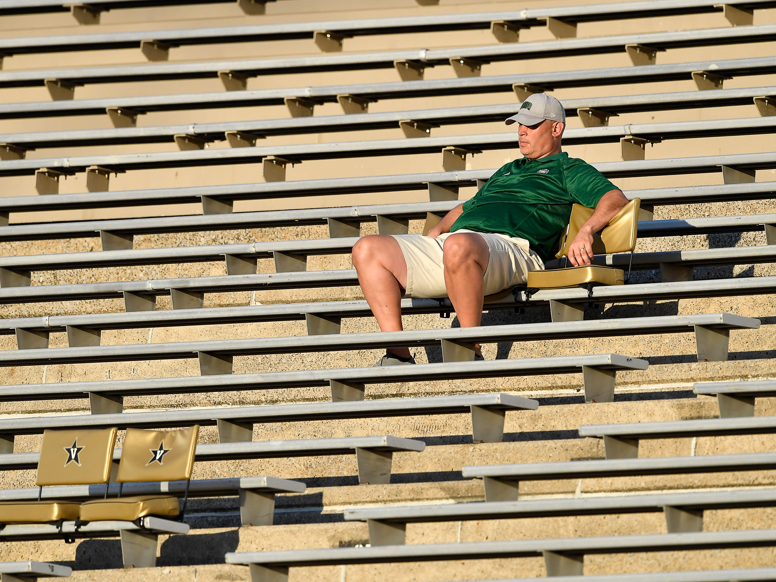 An Ohio fan watches his Bobcats as they play against Virginia Saturday, Sept. 15, 2018, in Nashville, Tenn. at Vanderbilt Stadium. Their football game was moved from Virginia to Tennessee to avoid the effects of Hurricane Florence.