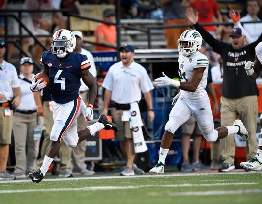 Virginia's Olamide Zaccheaus (4) races for touchdown against Vanderbilt on Sept. 15.