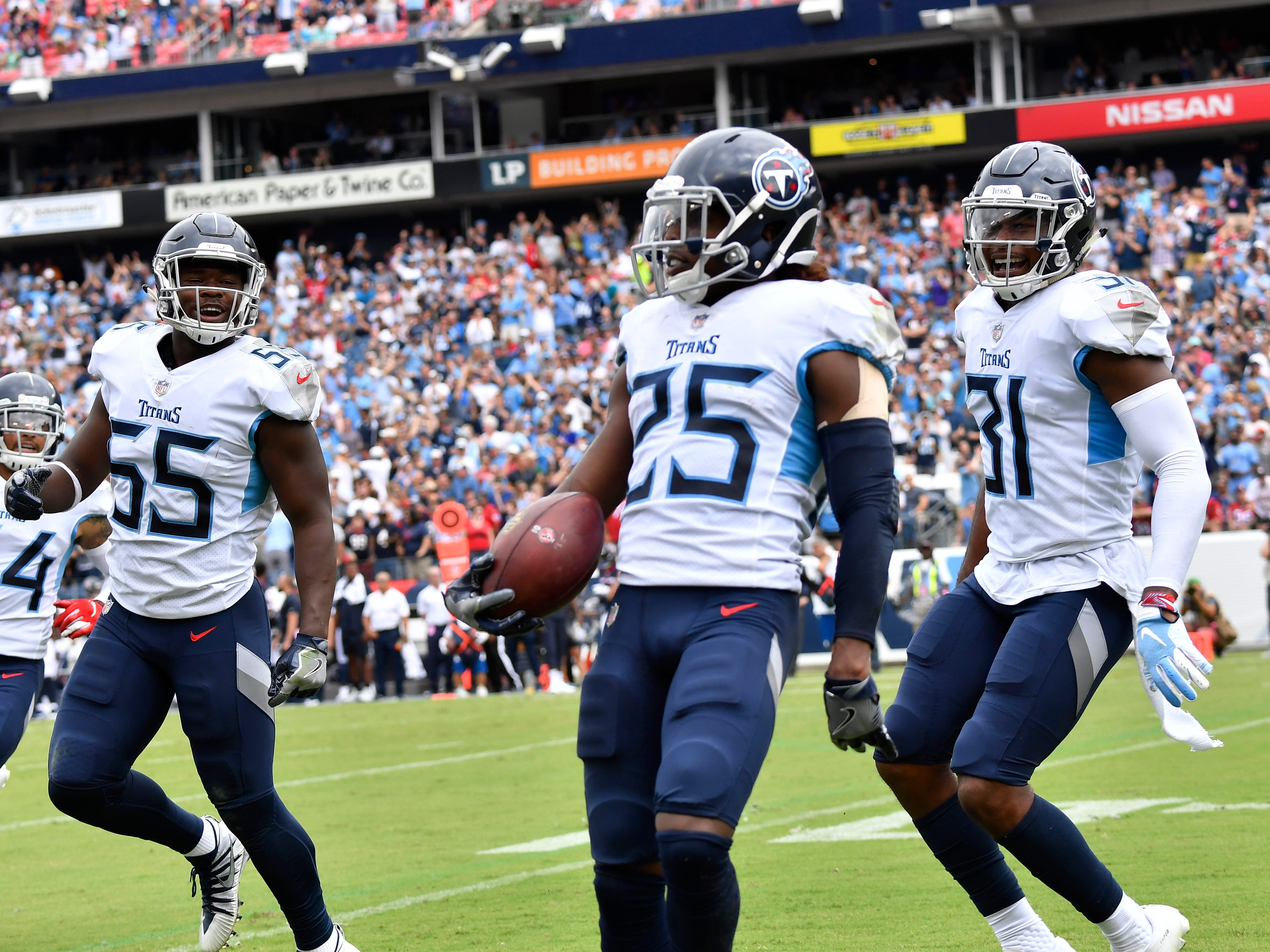 Titans cornerback Adoree' Jackson (25) celebrates his interception in the end zone in the second quarter at Nissan Stadium Sunday, Sept. 16, 2018, in Nashville, Tenn.