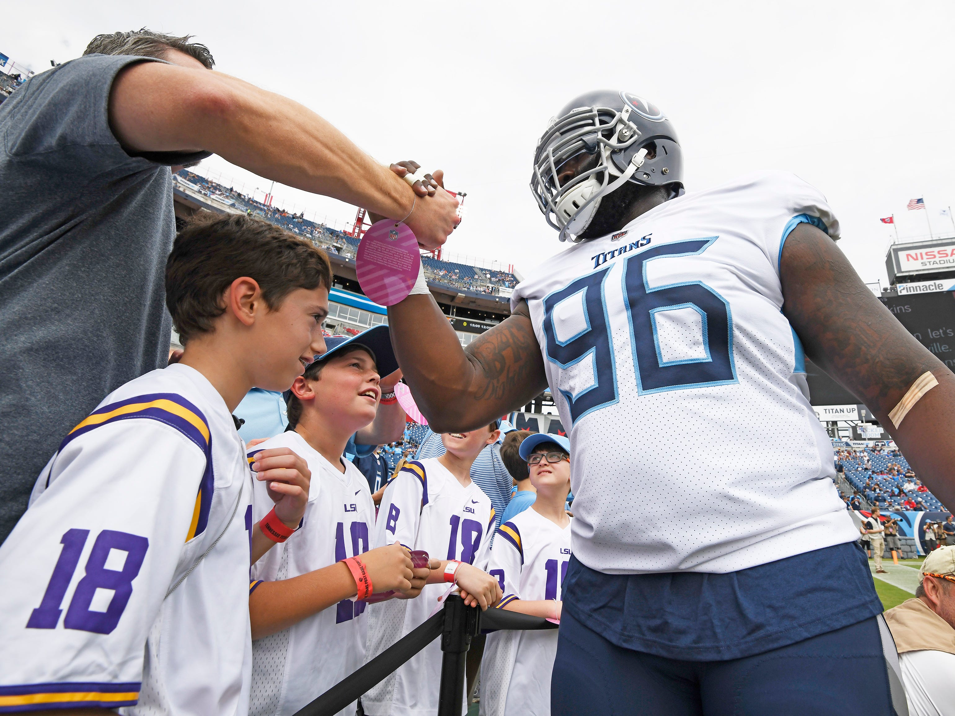 Titans defensive tackle Bennie Logan (96) slaps hands with fans before the game at Nissan Stadium Sunday, Sept. 16, 2018, in Nashville, Tenn.