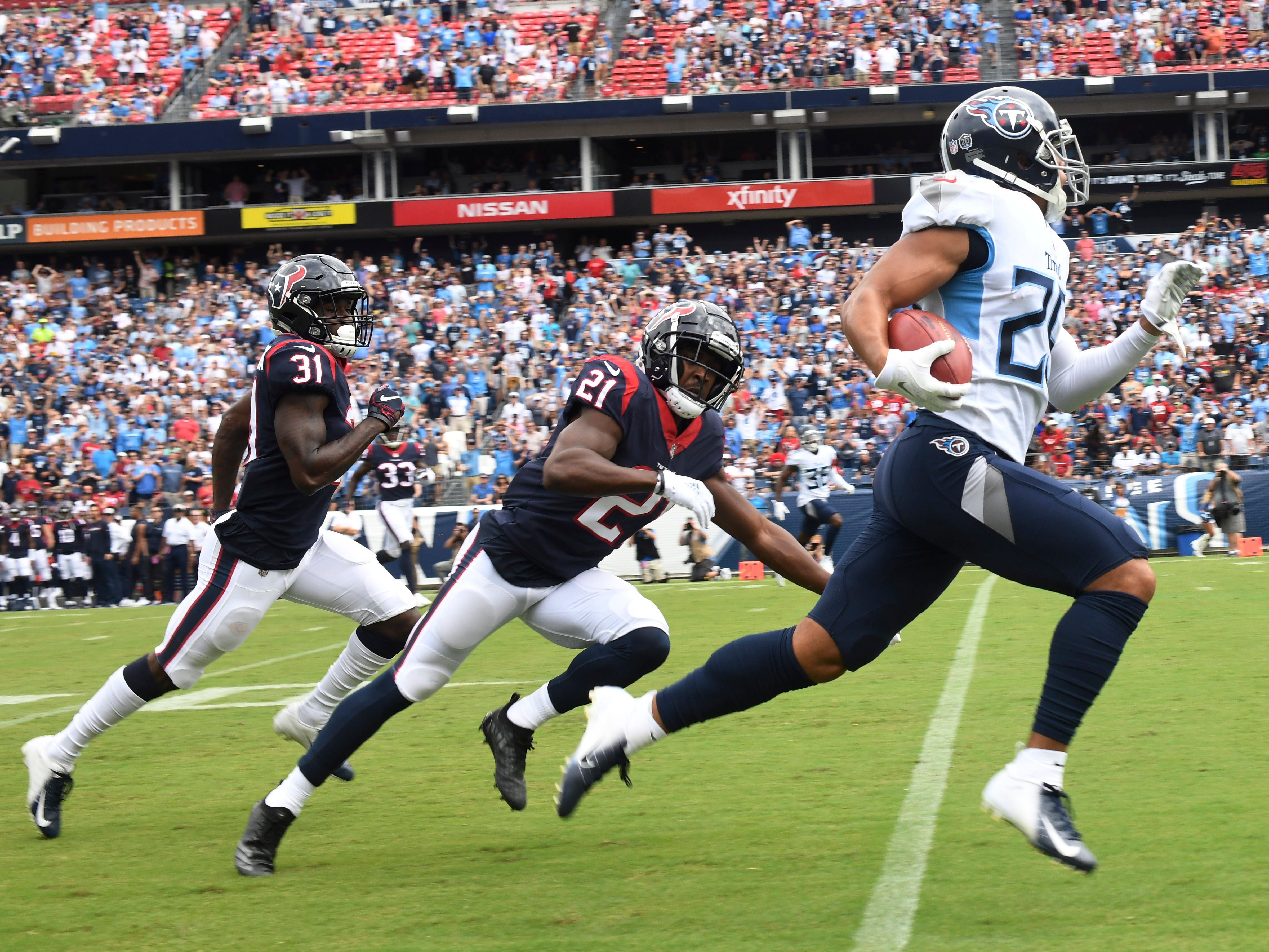 Titans cornerback Dane Cruikshank (29) takes off on his touchdown run in the first quarter at Nissan Stadium Sunday, Sept. 16, 2018, in Nashville, Tenn.