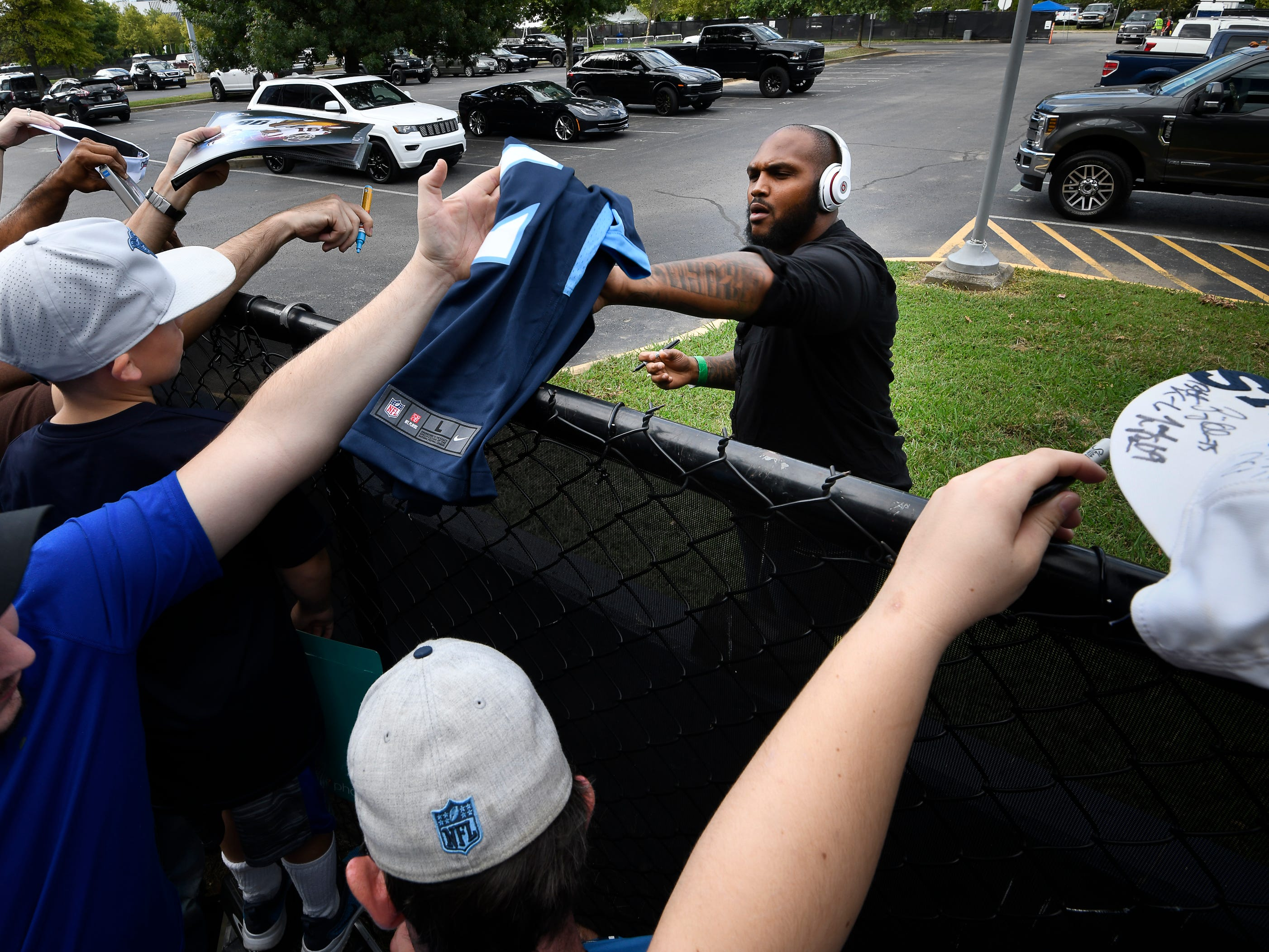 Titans defensive tackle Jurrell Casey signs autographs for fans before the game against the Texans at Nissan Stadium Sunday, Sept. 16, 2018, in Nashville, Tenn.