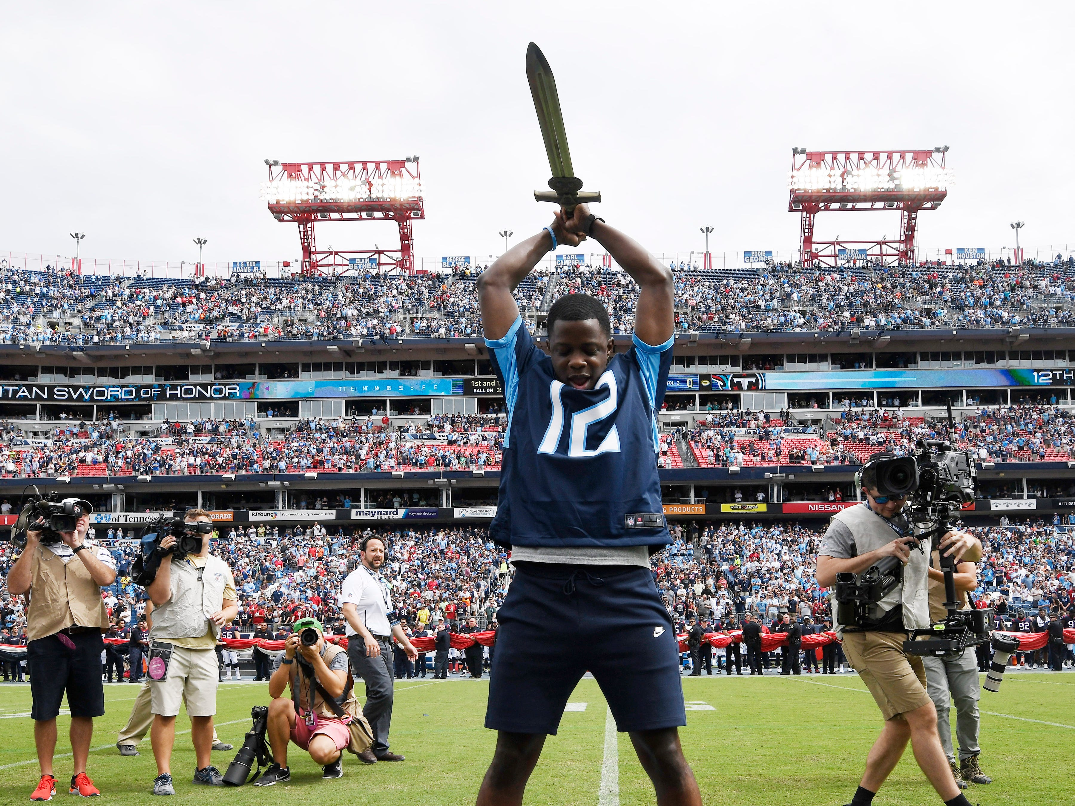 Waffle House shooting hero serves as the Titans' 12th man during pregame ceremonies at Nissan Stadium Sunday, Sept. 16, 2018, in Nashville, Tenn.