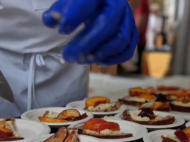 Chef Margot McCormack prepares stone fruit tarte tatin at the Music City Food + Wine Festival on Sept. 16, 2018. The cinnamon raisin bread is topped with fresh fruit, mascarpone, homemade granola and basil microgreens, along with a drizzle of Tennessee artisan honey.